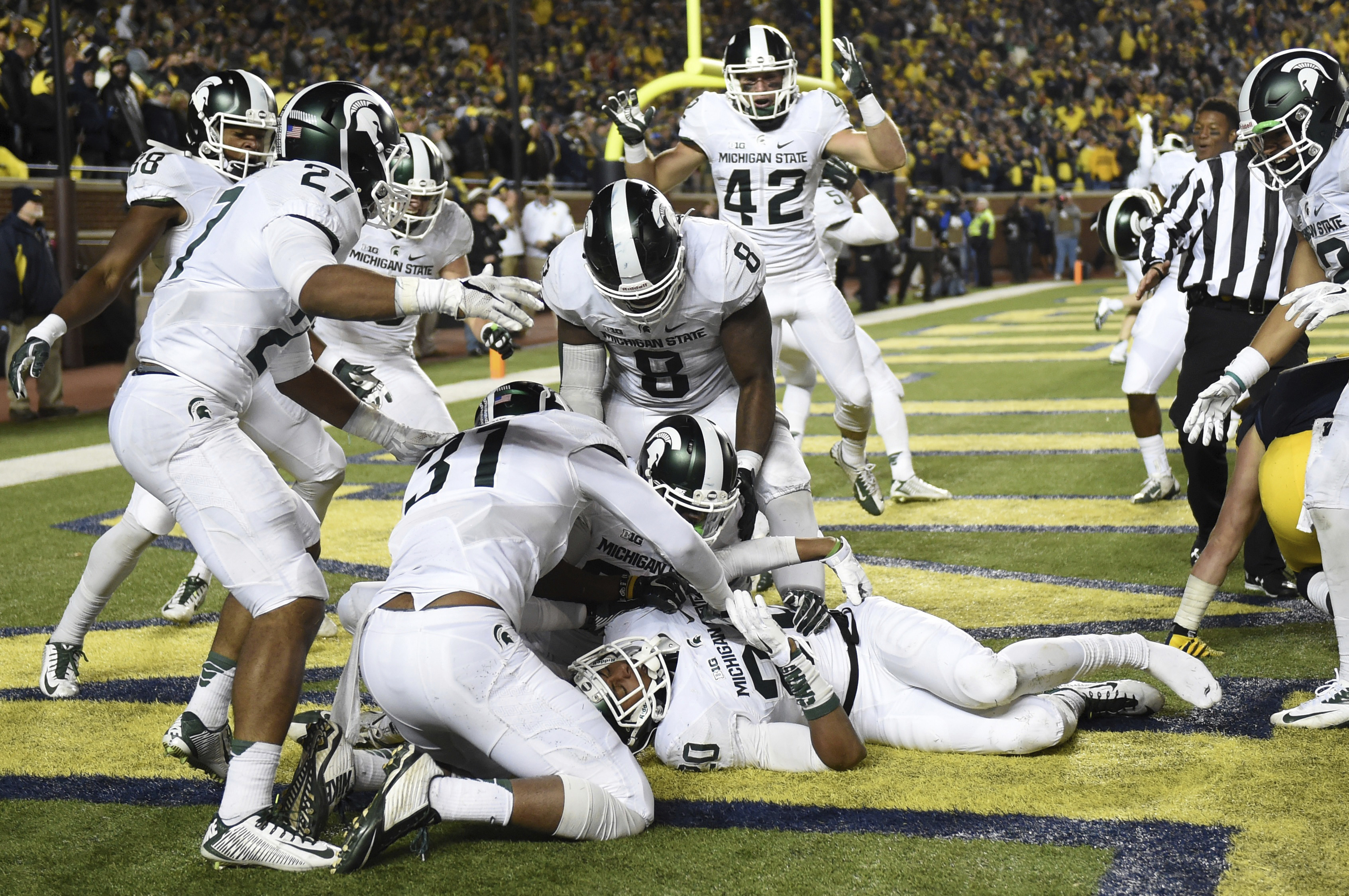 FILE - In this Oct. 17, 2015, file photo, Michigan State defensive back Jalen Watts-Jackson (20) is surrounded by teammates celebrating after he recovered a fumble on a punt in the closing seconds of the second half and returned it for a touchdown during