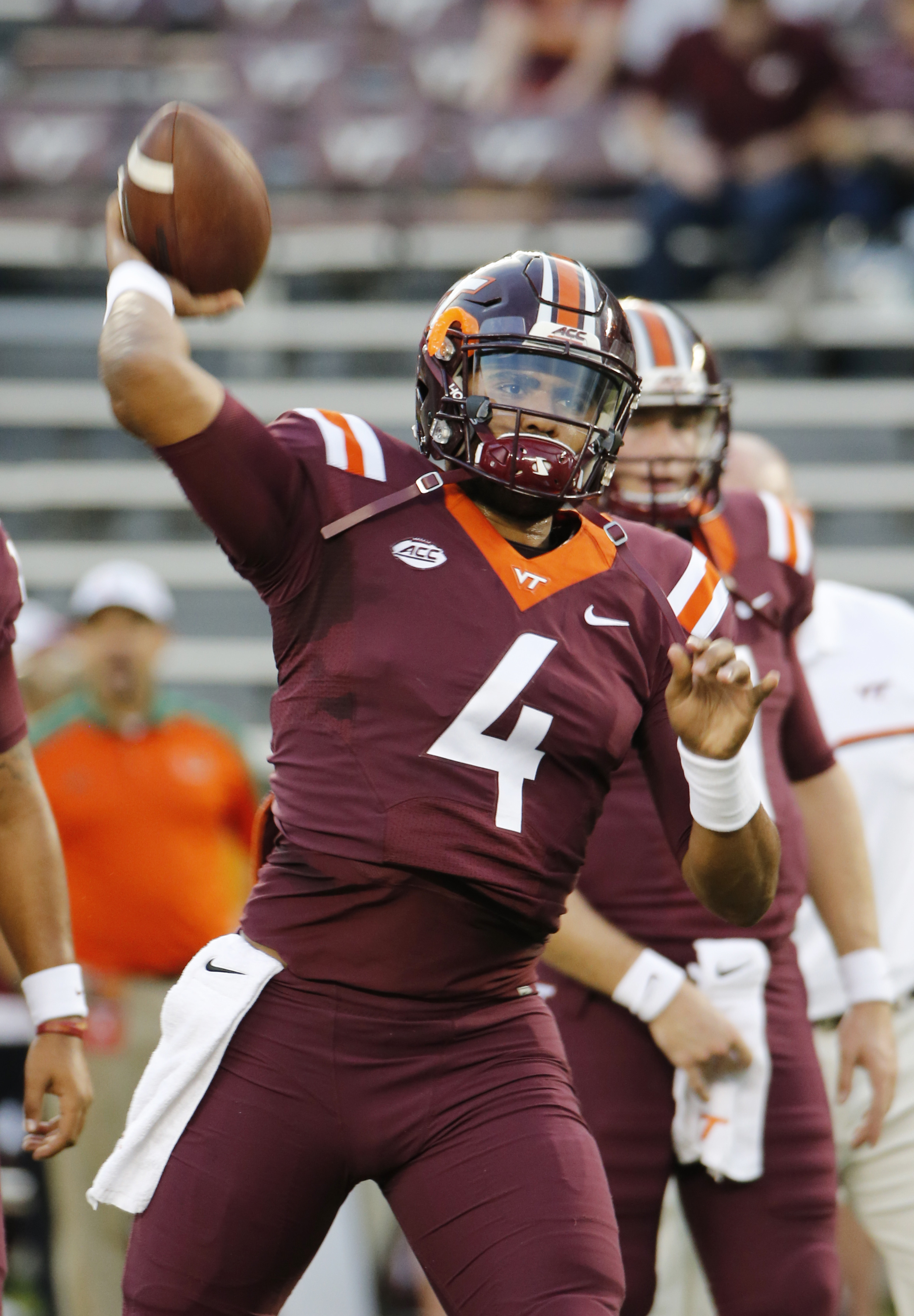 FILE - In this Oct. 20, 2016, file photo, Virginia Tech quarterback Jerod Evans (4) tosses a pass prior to the start of the Miami-Virginia Tech NCAA college football game at Lane stadium in Blacksburg, Va. Virginia Tech has its destiny in its hands if it