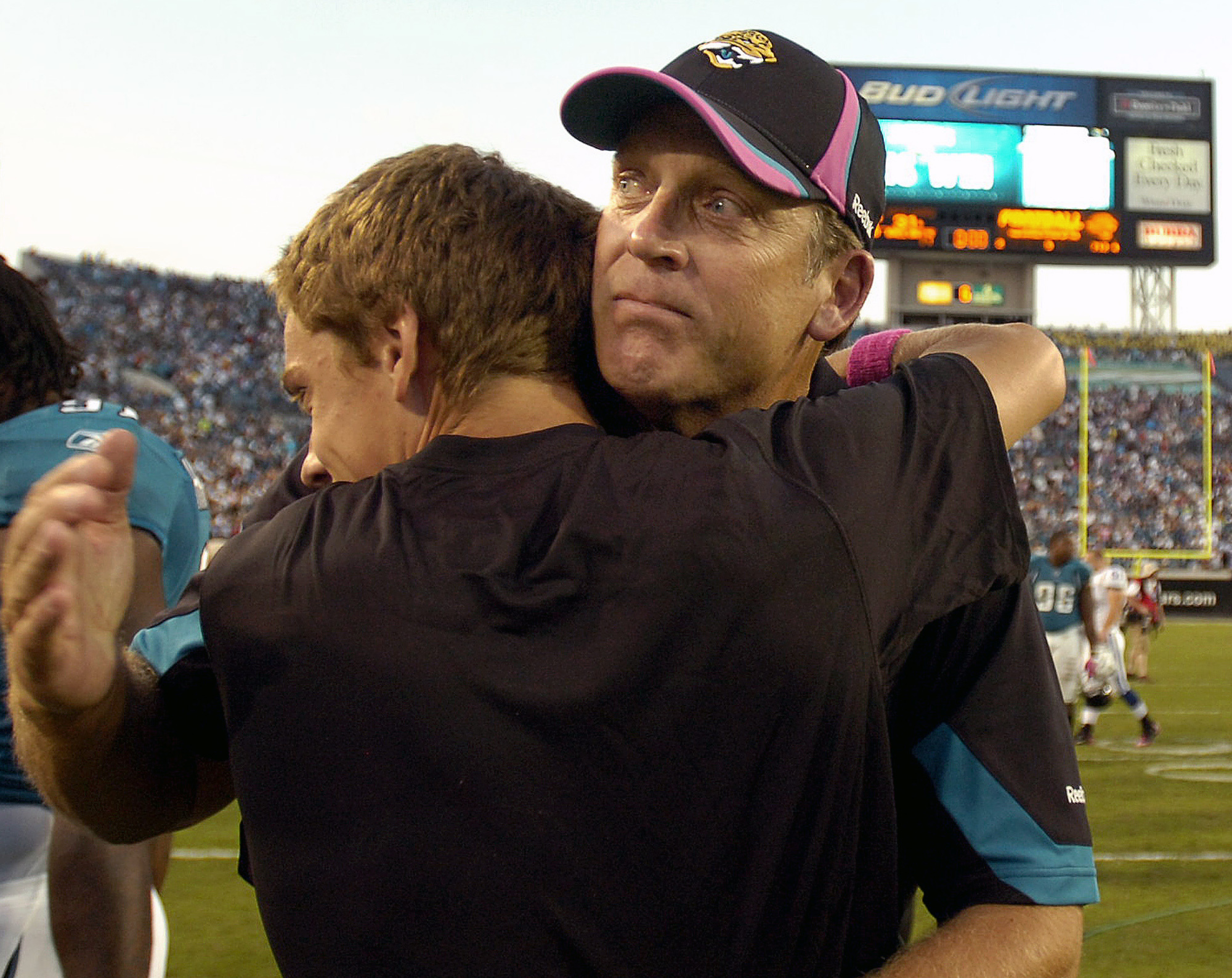 Jacksonville Jaguars head coach Jack Del Rio , right, hugs his son Luke Del Rio after defeating the Indianapolis Colts with a last-second field goal during an NFL football game, Sunday, Oct. 3, 2010, in Jacksonville, Fla. Luke Del Rio will return to Jacks