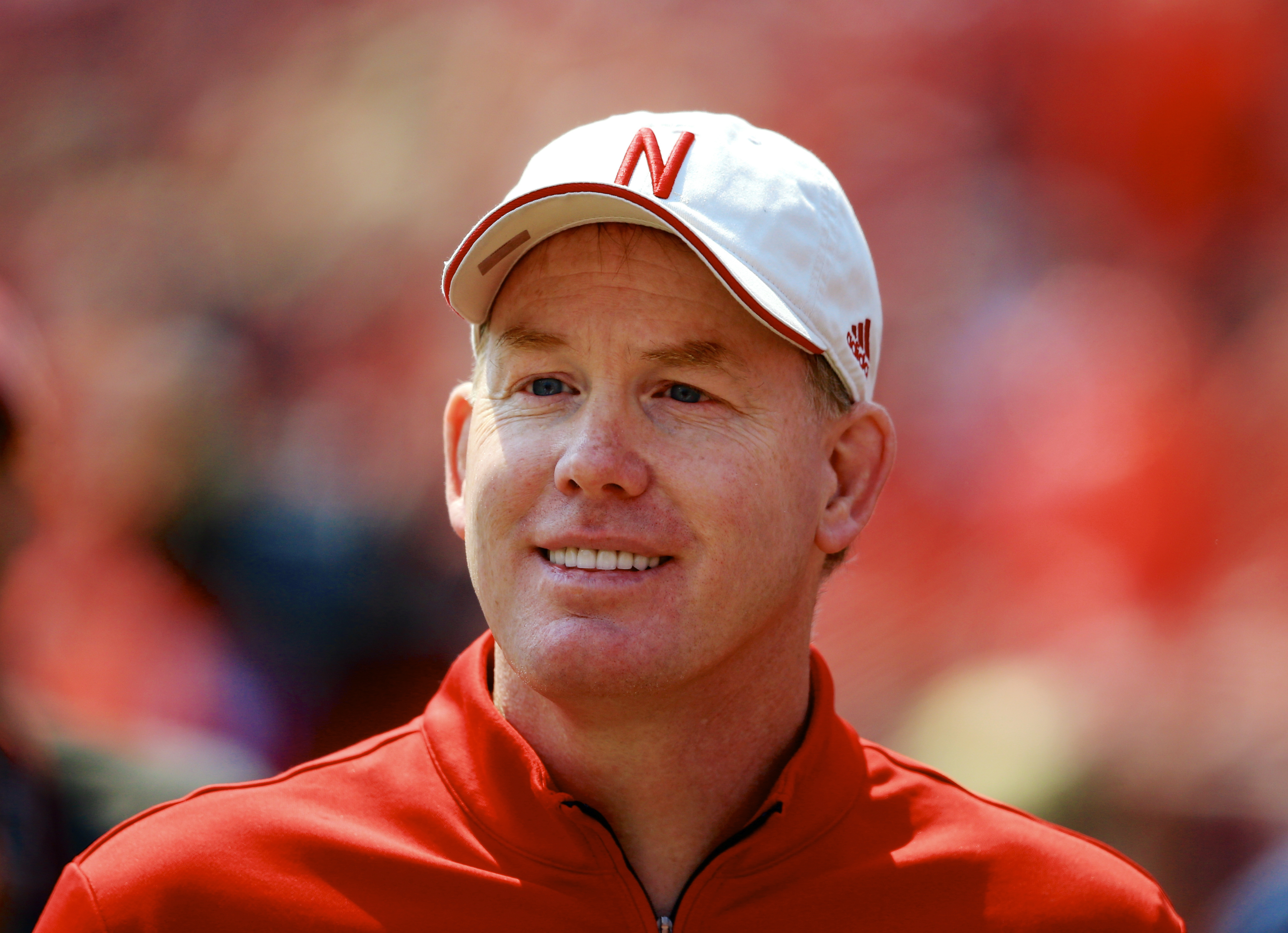 FILE - In this April 11, 2015 file photo, Nebraska Athletic Director Shawn Eichorst stands on the sidelines during a football game in Lincoln, Neb. The NCAA committee that crafted proposed football recruiting reforms, which includes the addition of early