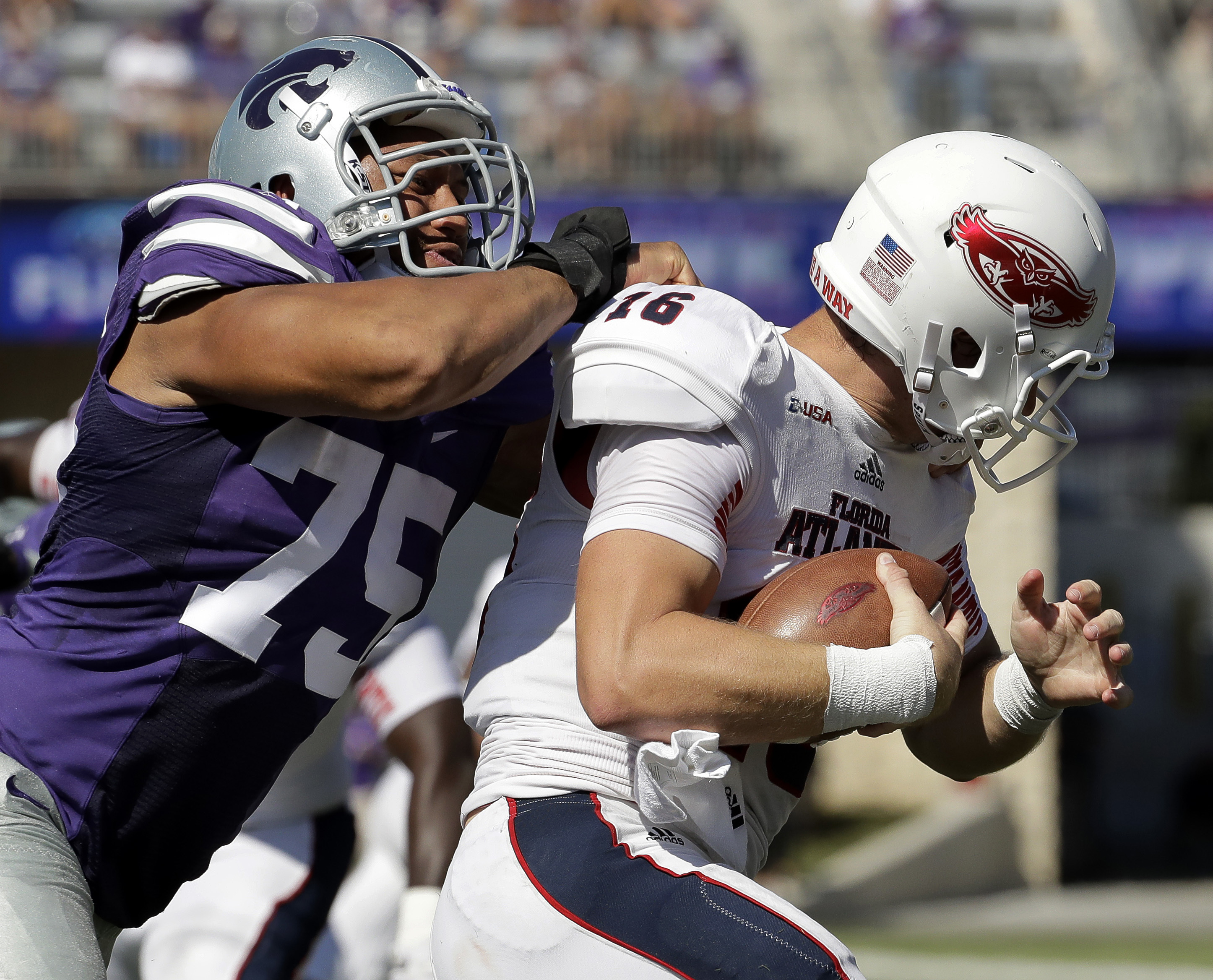 FILE - In this Sept. 17, 2016, file photo, Florida Atlantic quarterback Jason Driskel (16) is sacked by Kansas State defensive end Jordan Willis (75) during the first half of an NCAA college football game, in Manhattan, Kan. Perhaps the reason that Willis