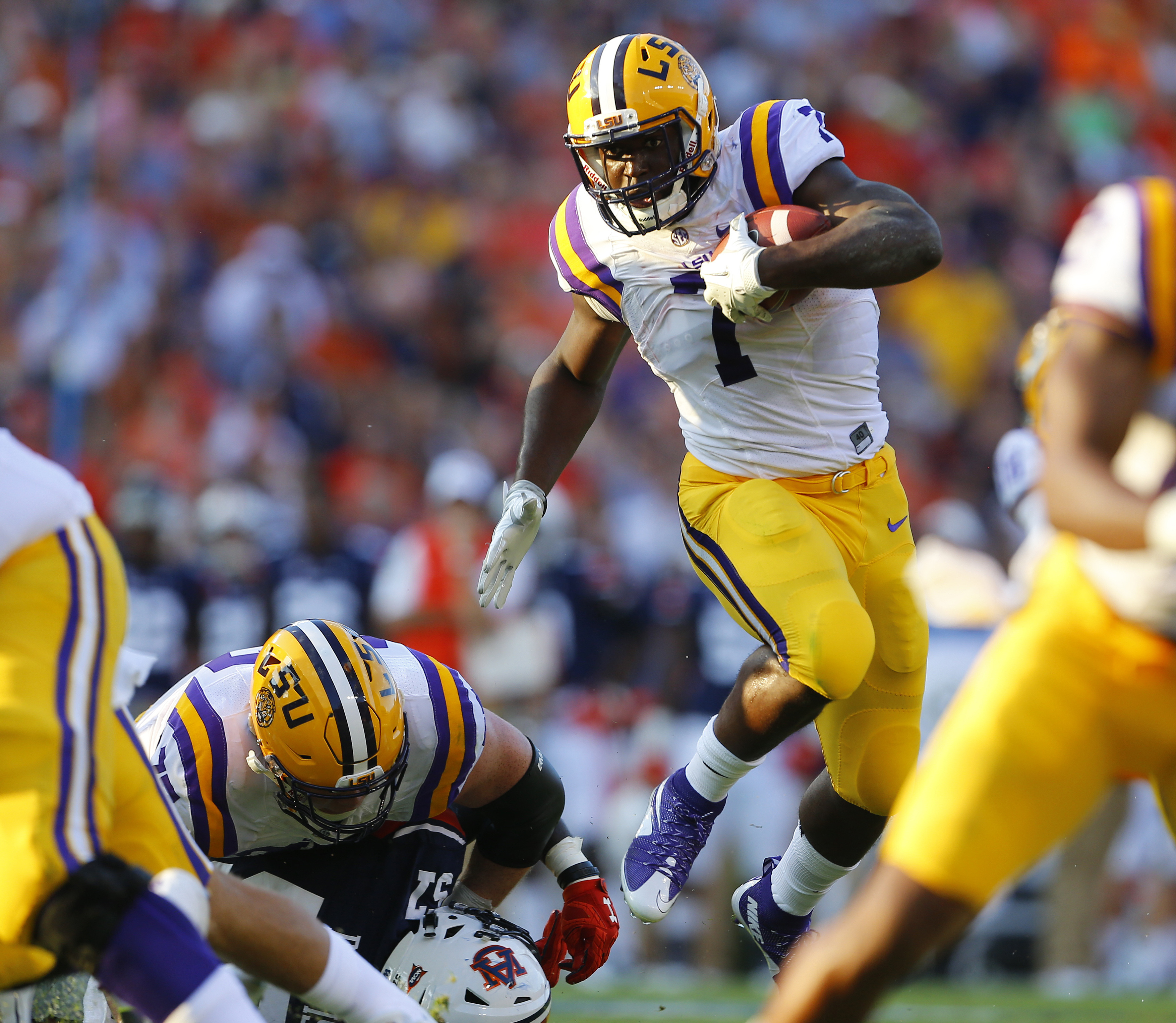 FILE - In this Sept. 24, 2016, file photo, LSU running back Leonard Fournette (7) hurdles an Auburn player as he carries the ball during the first half of an NCAA college football game,  in Auburn, Ala. Even after missing four games with injuries, Leonard