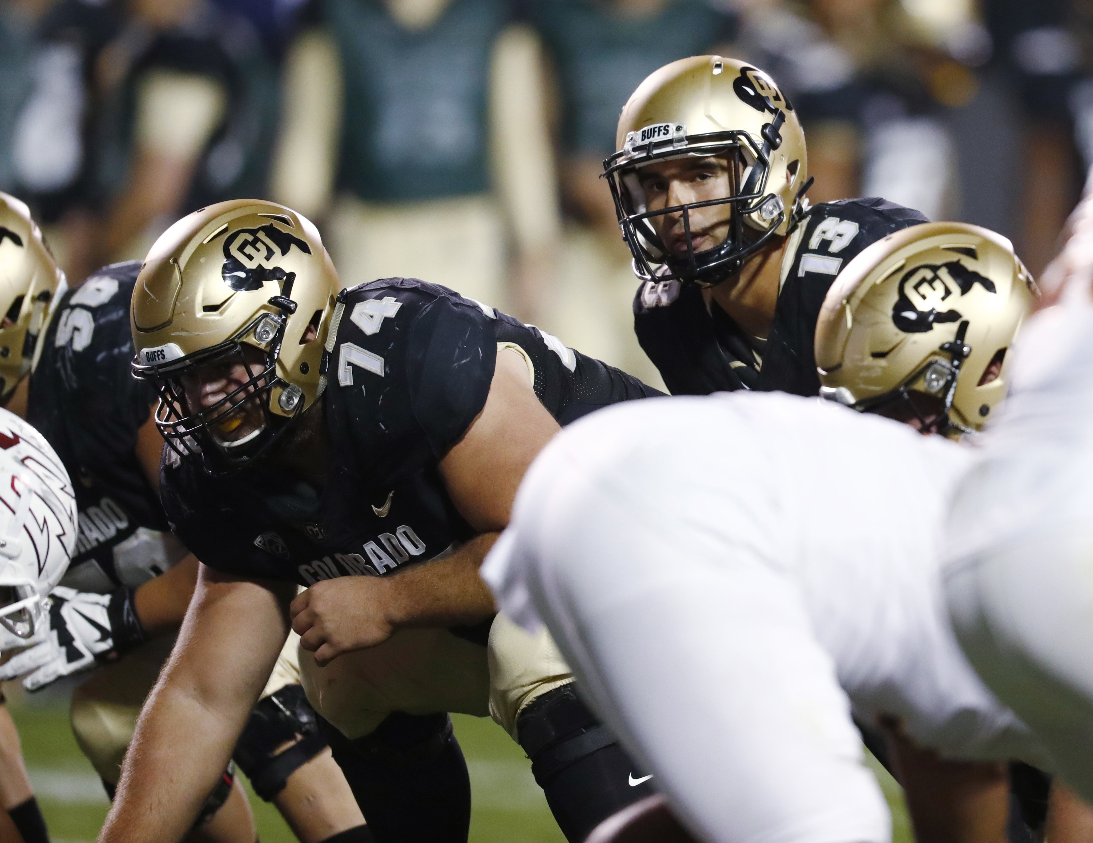 In this Saturday, Oct. 15, 2016 photo, Colorado center Alex Kelley, left, waits to snap the ball to quarterback Sefo Liufau during the second half of an NCAA college football game against Arizona State  in Boulder, Colo. Kelley is following in the footste