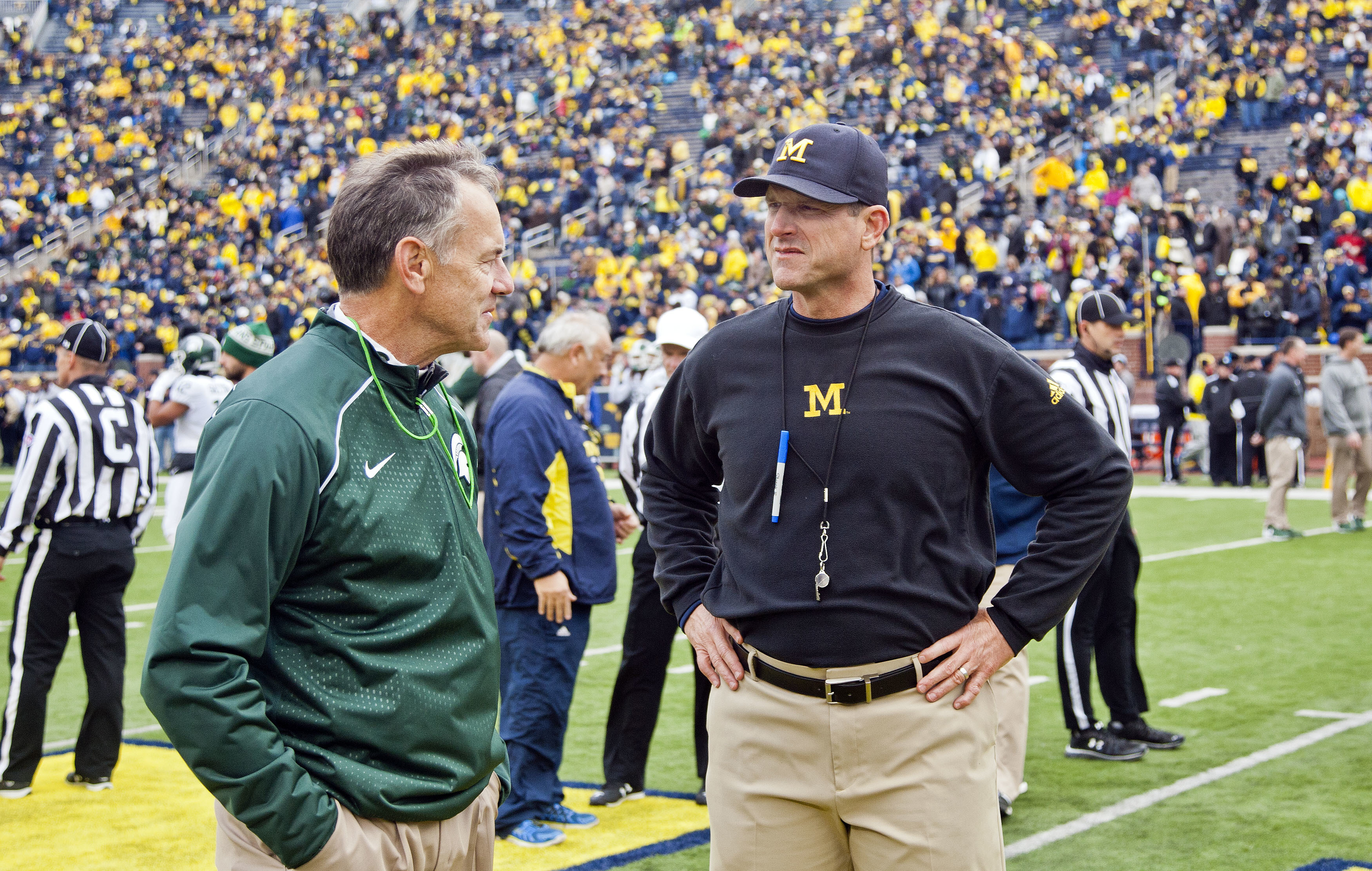 FILE - In this Oct. 17, 2015, file photo, Michigan State head coach Mark Dantonio, left, chats with Michigan head coach Jim Harbaugh before an NCAA college football game in Ann Arbor, Mich. Ohio State's last Saturday to Penn State has created this somewha