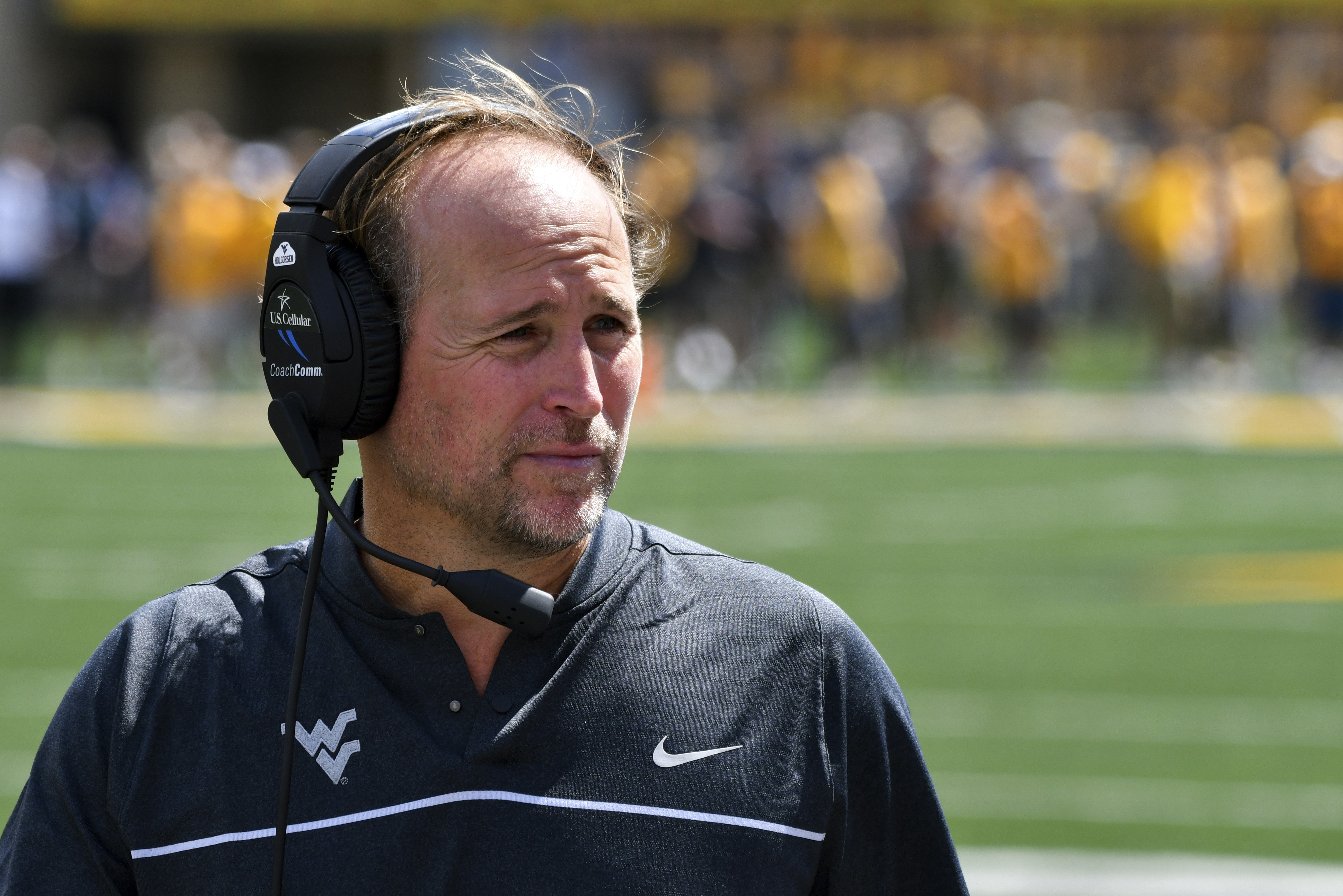 FILE - In this Sept. 3, 2016, file photo, West Virginia head coach Dana Holgorsen watches during the first half of an NCAA college football game against Missouri in Morgantown, W.Va. With Baylor and West Virginia still undefeated before the first CFP rank