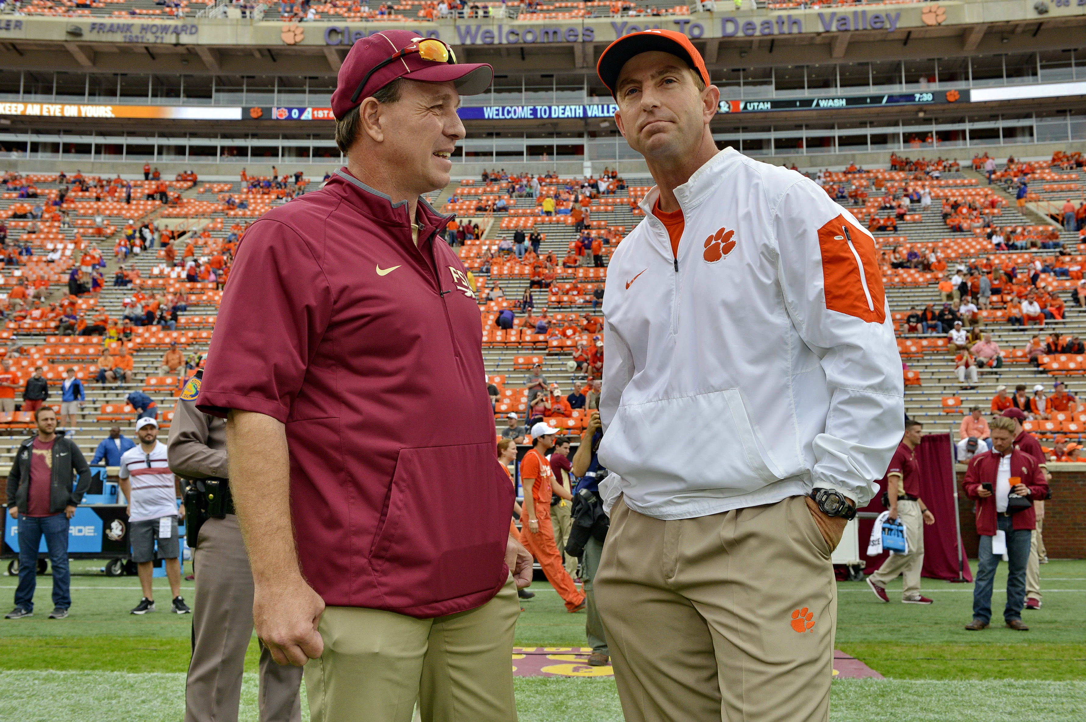 FILE - In this Nov. 7, 2015, file photo, Florida State head coach Jimbo Fisher, left, and Clemson head coach Dabo Swinney talk before the start of an NCAA college football game in Clemson, S.C. Another Clemson-Florida State matchup in the Top 25, another