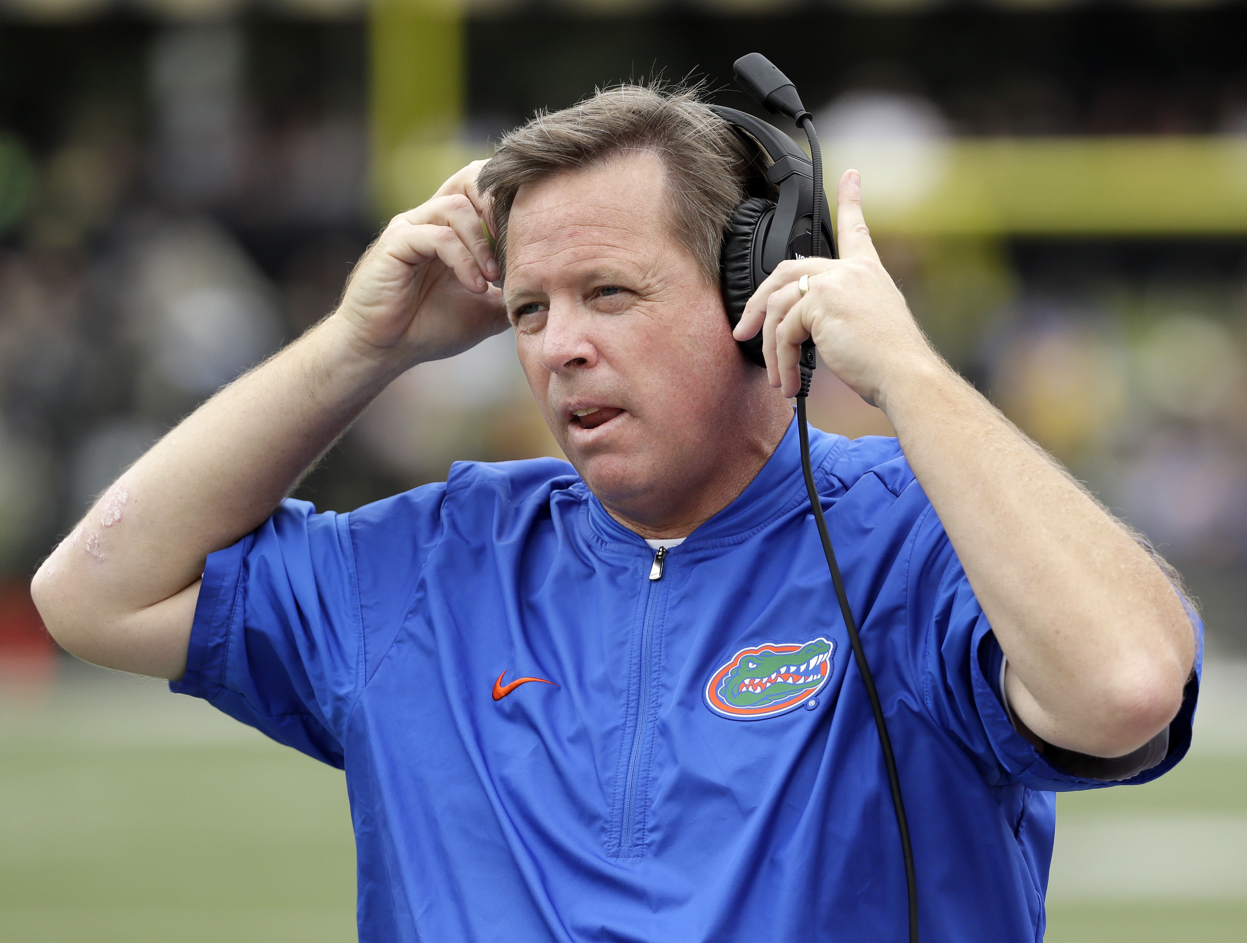 FILE - In this Oct. 1, 2016, file photo, Florida head coach Jim McElwain watches from the sideline in the second half of an NCAA college football game against Vanderbilt in Nashville, Tenn. Georgia head coach Kirby Smart and McElwain become close friends