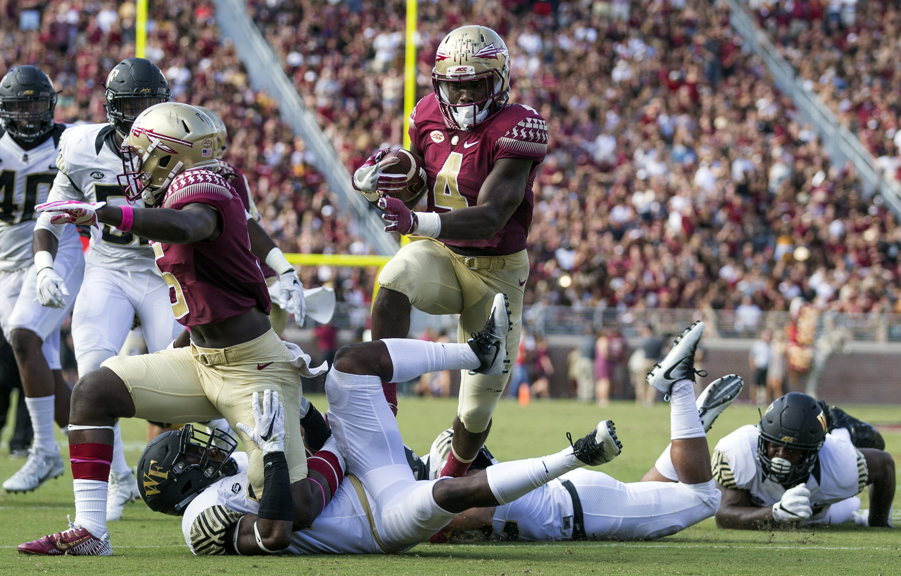 FILE - In this Saturday, Oct. 15, 2016, photo, Florida State running back Dalvin Cook runs against Wake Forest in the first half of an NCAA college football game in Tallahassee, Fla. Cook and Clemson quarterback Deshaun Watson have the potential to make a