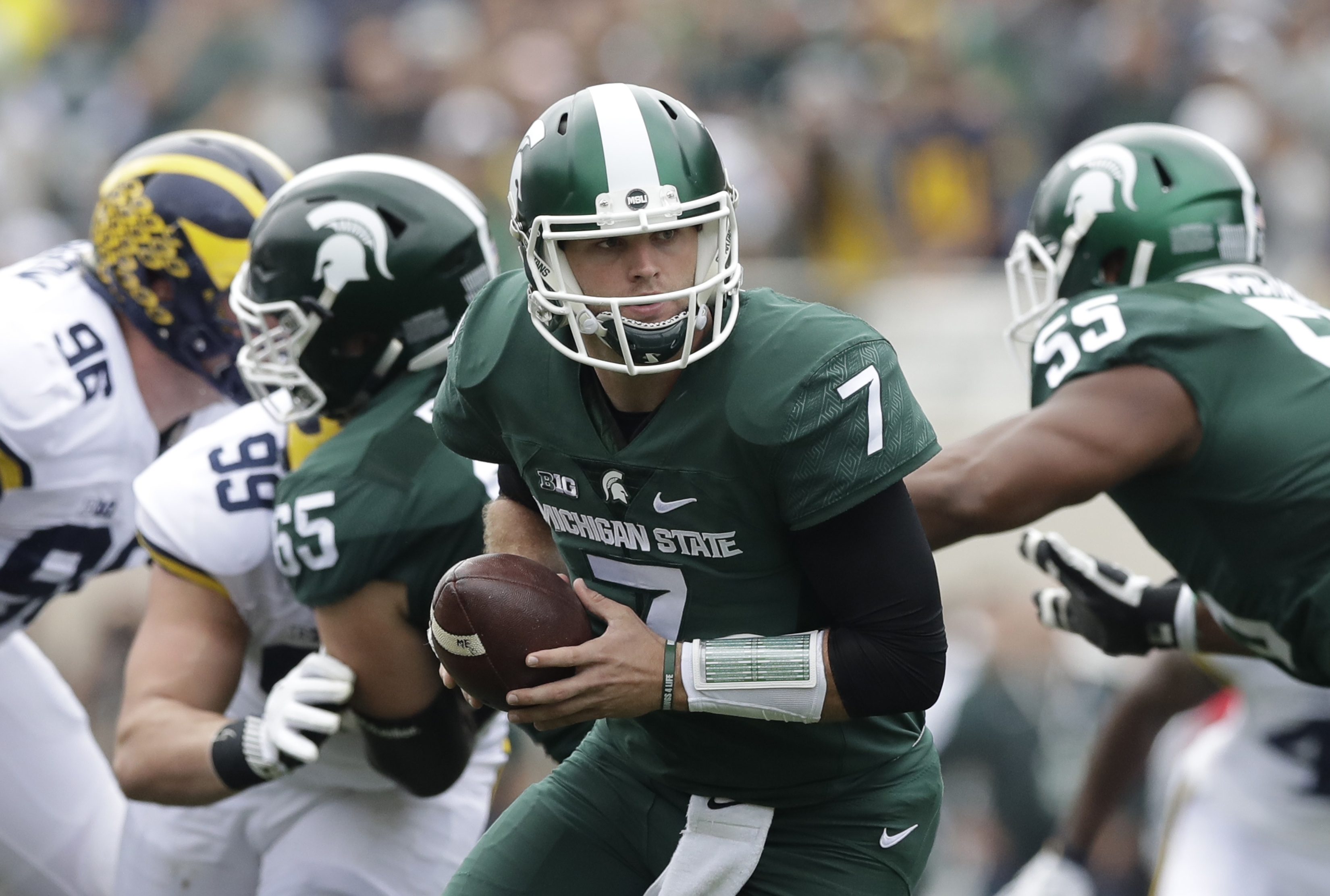 Michigan State quarterback Tyler O'Connor (7) gets ready to hands off the ball during the first half of an NCAA college football game against Michigan, Saturday, Oct. 29, 2016, in East Lansing, Mich. (AP Photo/Carlos Osorio)