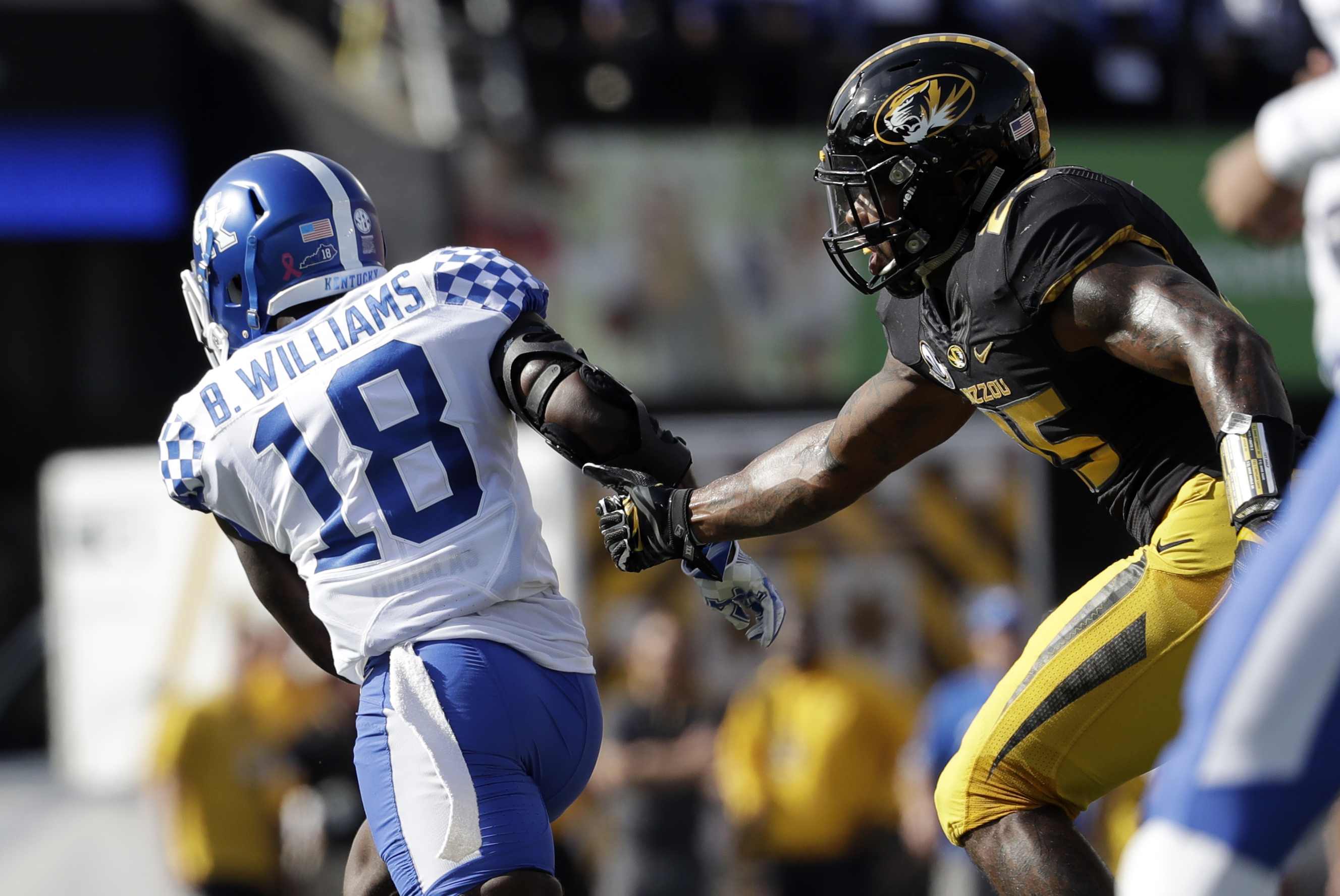 Kentucky running back Stanley Williams, left, slips past Missouri linebacker Donavin Newsom on his way to a 60-yard touchdown run during the first half of an NCAA college football game Saturday, Oct. 29, 2016, in Columbia, Mo. (AP Photo/Jeff Roberson)