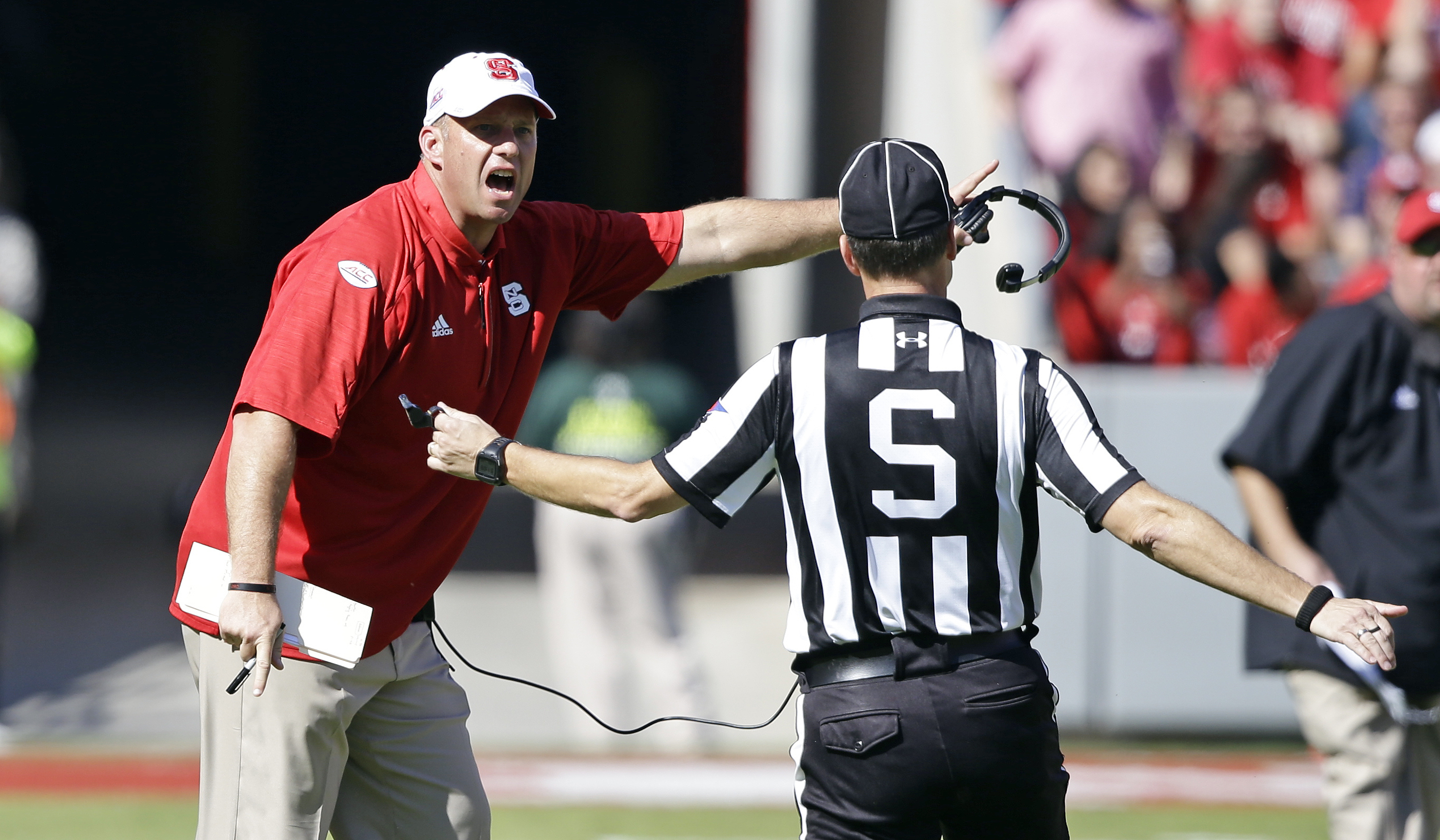 North Carolina State head coach Dave Doeren yells at an official during the first half of an NCAA college football game against Boston College in Raleigh, N.C., Saturday, Oct. 29, 2016. (AP Photo/Gerry Broome)