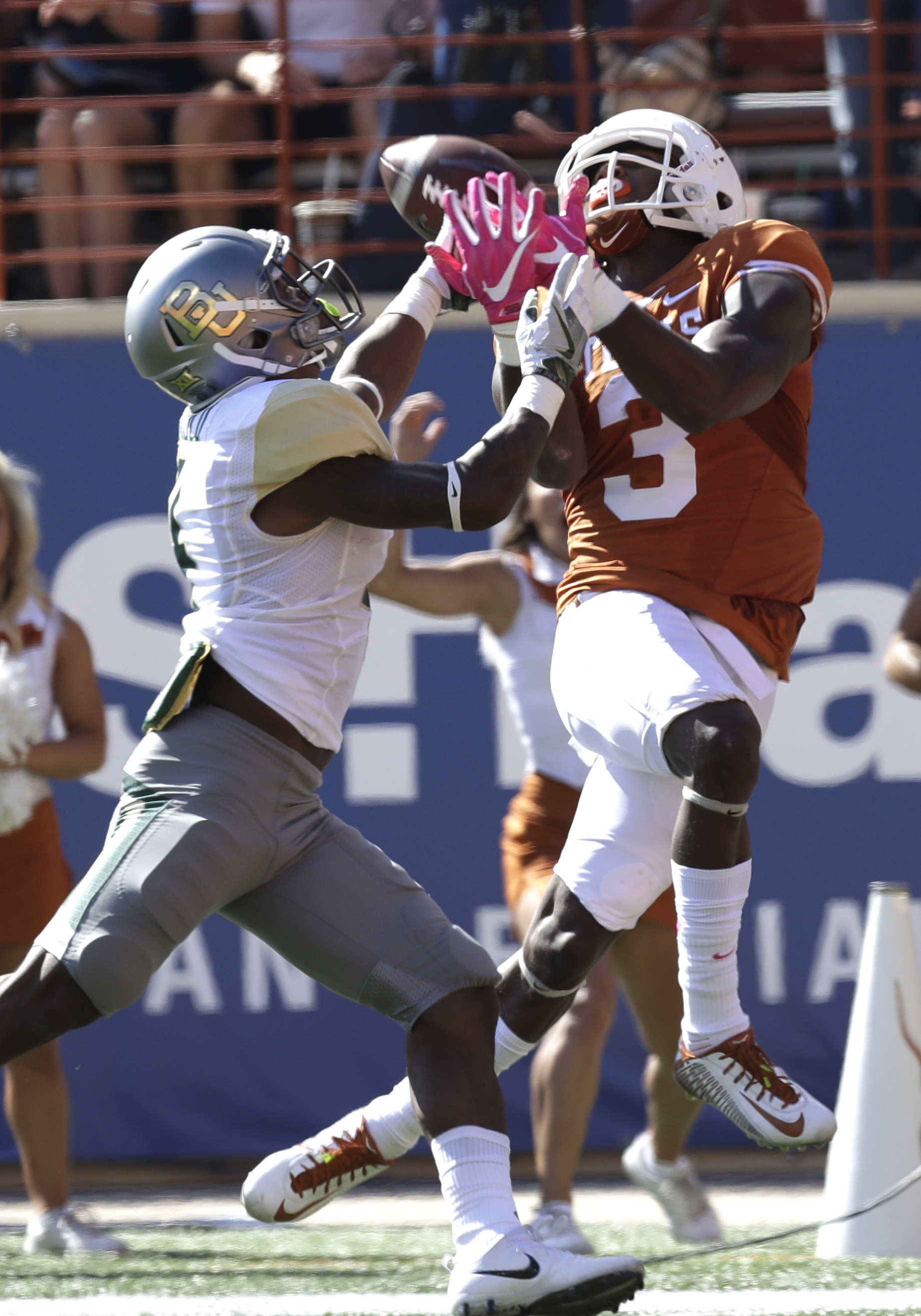 Texas wide receiver Armanti Foreman (3) makes a 40-yard catch over Baylor cornerback Grayland Arnold (4) during the first half on a NCAA college football game, Saturday, Oct. 29, 2016, in Austin, Texas. (AP Photo/Eric Gay)