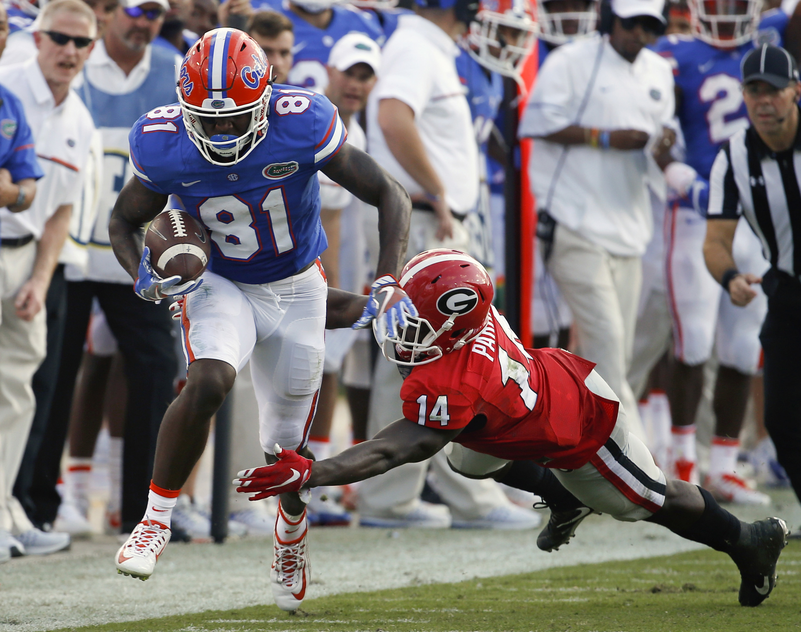 Florida wide receiver Antonio Callaway (81) runs against Georgia cornerback Malkom Parrish (14) during the first half of an NCAA college football game, Saturday, Oct. 29, 2016, in Jacksonville, Fla. (AP Photo/Stephen B. Morton)