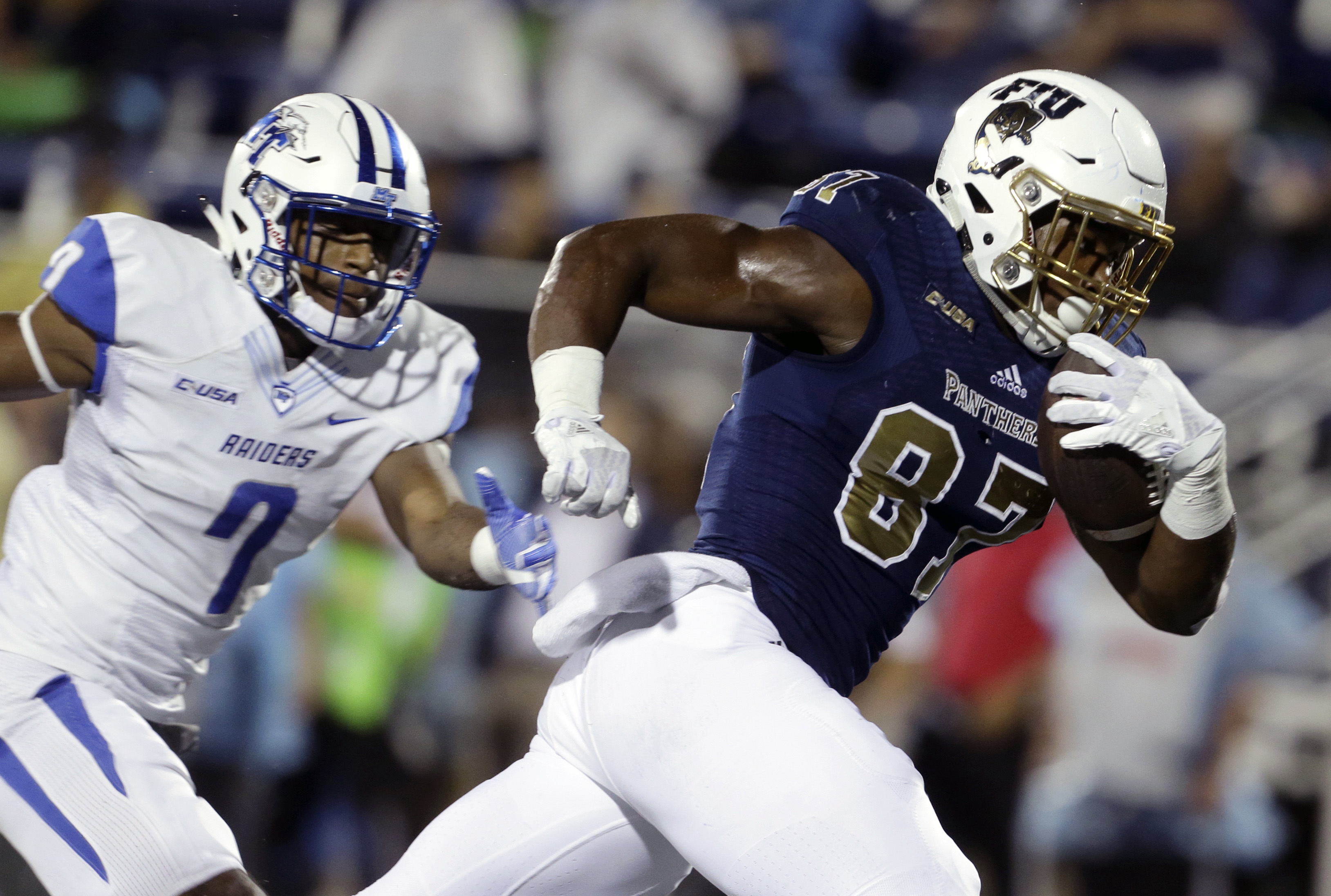 Florida International tight end Jonnu Smith (87) runs to score a touchdown as Middle Tennessee safety Jovante Moffatt (7) defends during the first half of an NCAA college football game, Saturday, Oct. 29, 2016, in Miami. (AP Photo/Lynne Sladky)
