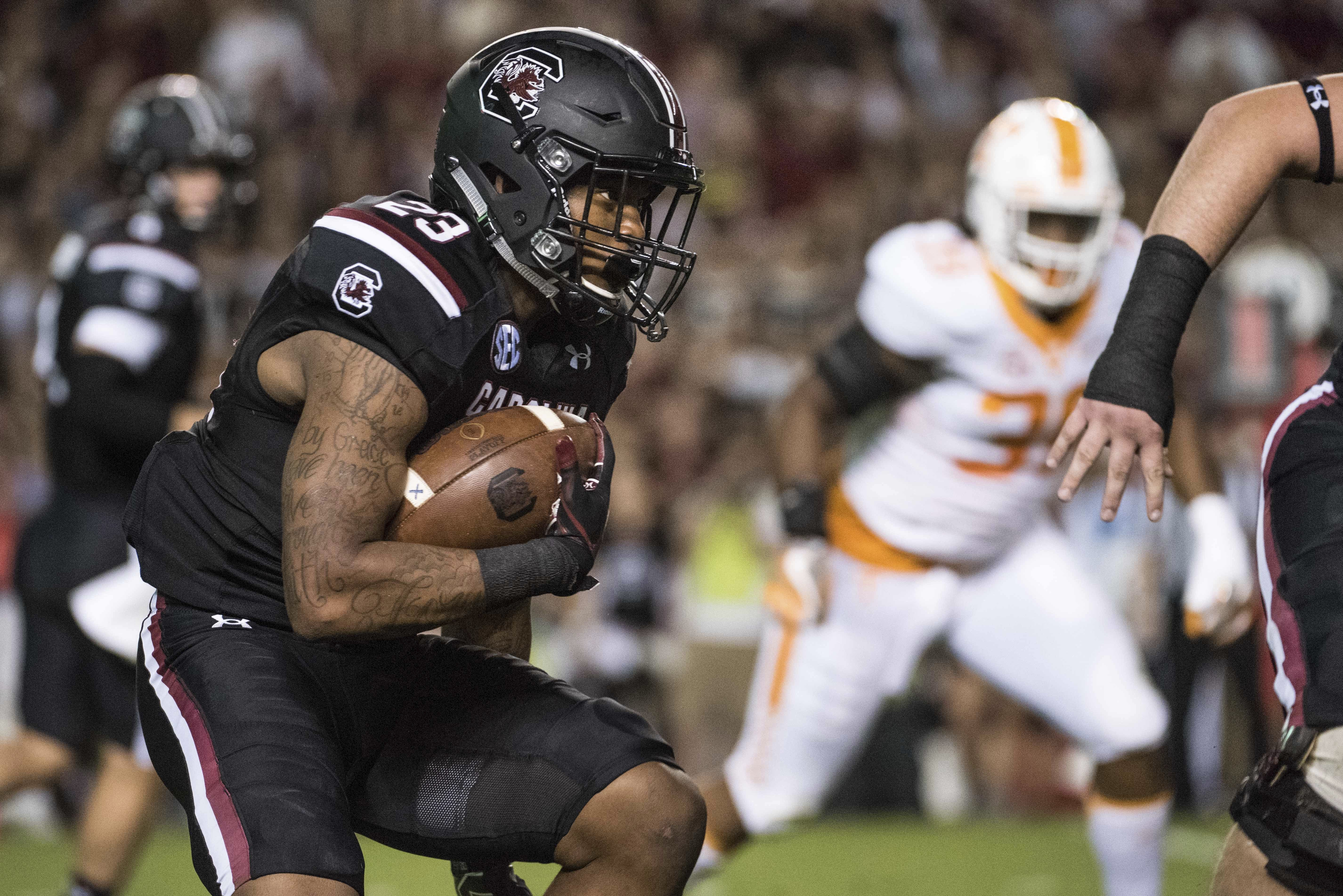 South Carolina running back Rico Dowdle runs the ball (23) during the first half of an NCAA college football game against Tennessee Saturday, Oct. 29, 2016, in Columbia, S.C. (AP Photo/Sean Rayford)
