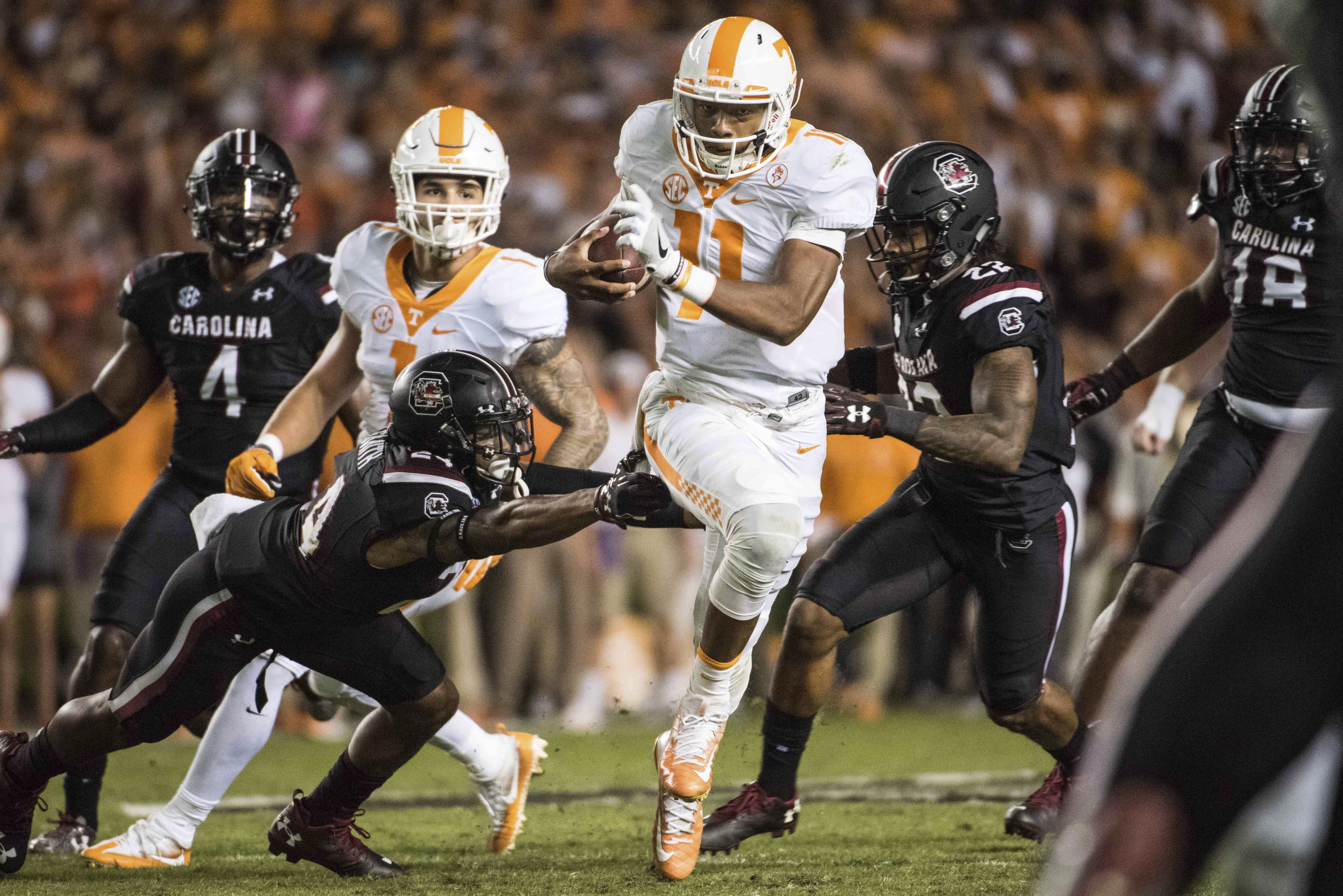 Tennessee quarterback Joshua Dobbs (11) runs the ball against South Carolina defensive back D.J. Smith (24) during the first half of an NCAA college football game Saturday, Oct. 29, 2016, in Columbia, S.C. (AP Photo/Sean Rayford)