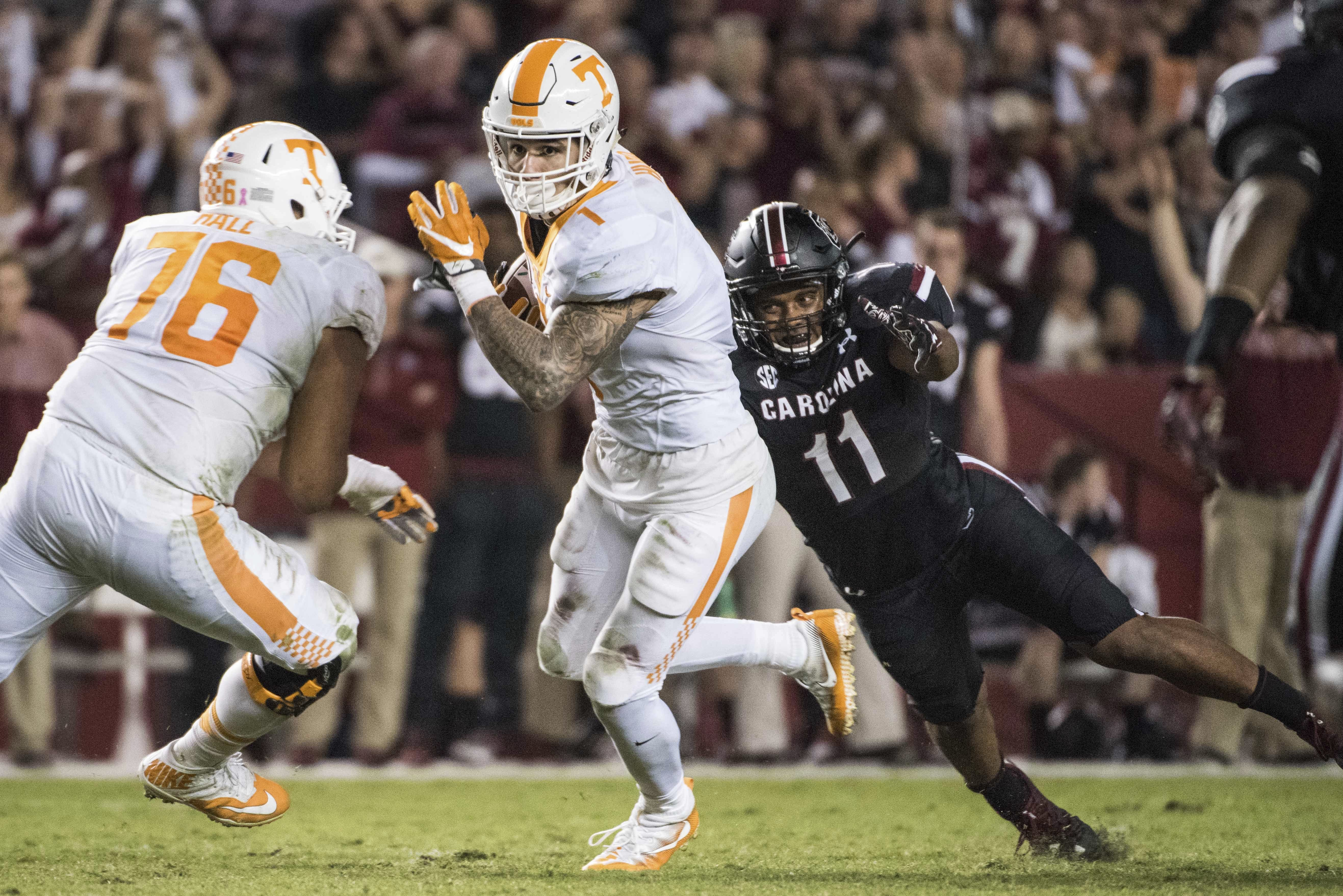 Tennessee running back Jalen Hurd (1) attempts to elude South Carolina linebacker T.J. Holloman (11) during the first half of an NCAA college football game Saturday, Oct. 29, 2016, in Columbia, S.C. South Carolina defeated Tennessee 24-21. (AP Photo/Sean