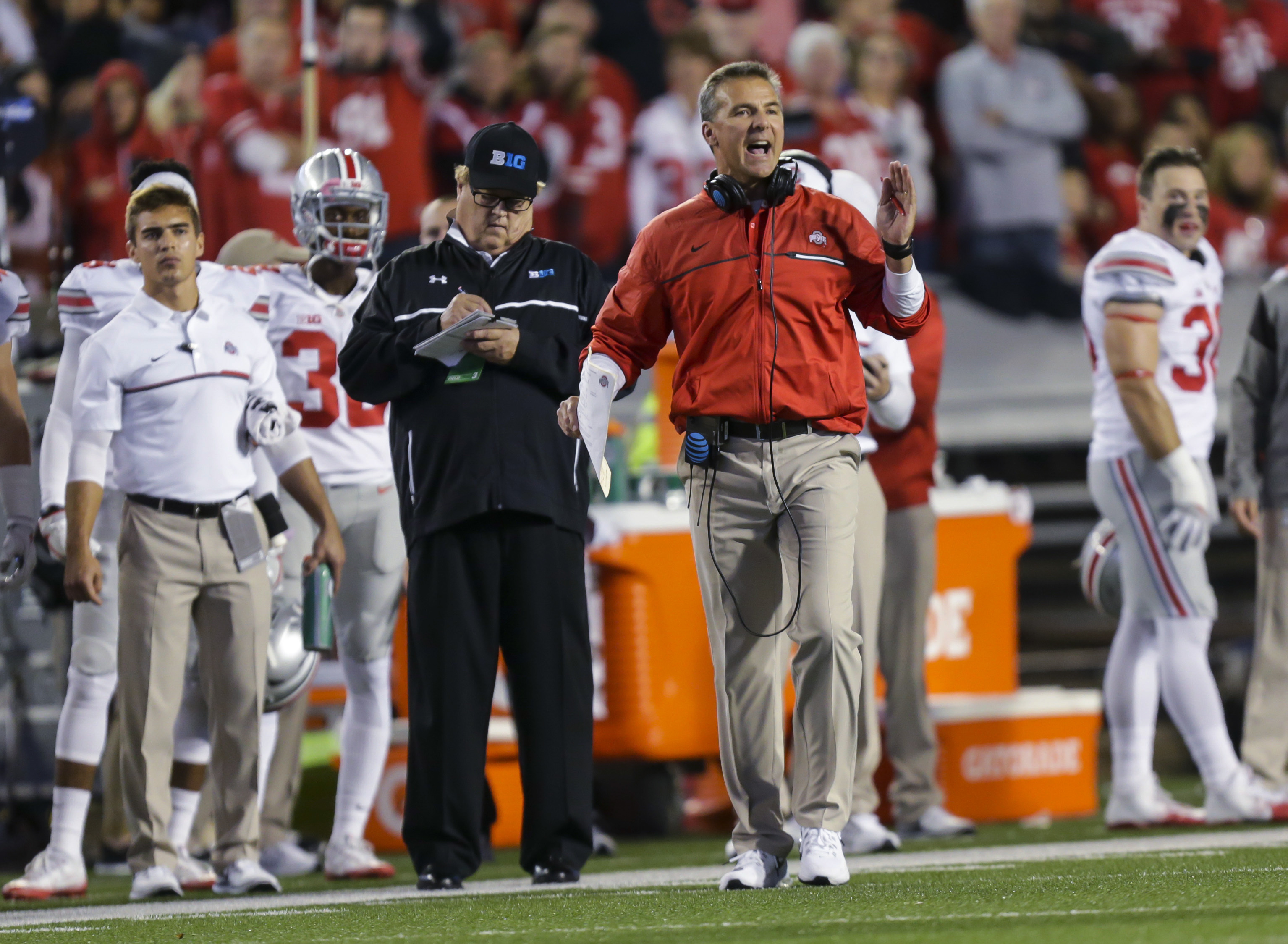 FILE - In this  Saturday, Oct. 15, 2016, file photo, Ohio State coach Urban Meyer disputes a call during the first half of the team's NCAA college football game against Wisconsin in Madison, Wis. After blowing away opponents in the first four games, Ohio