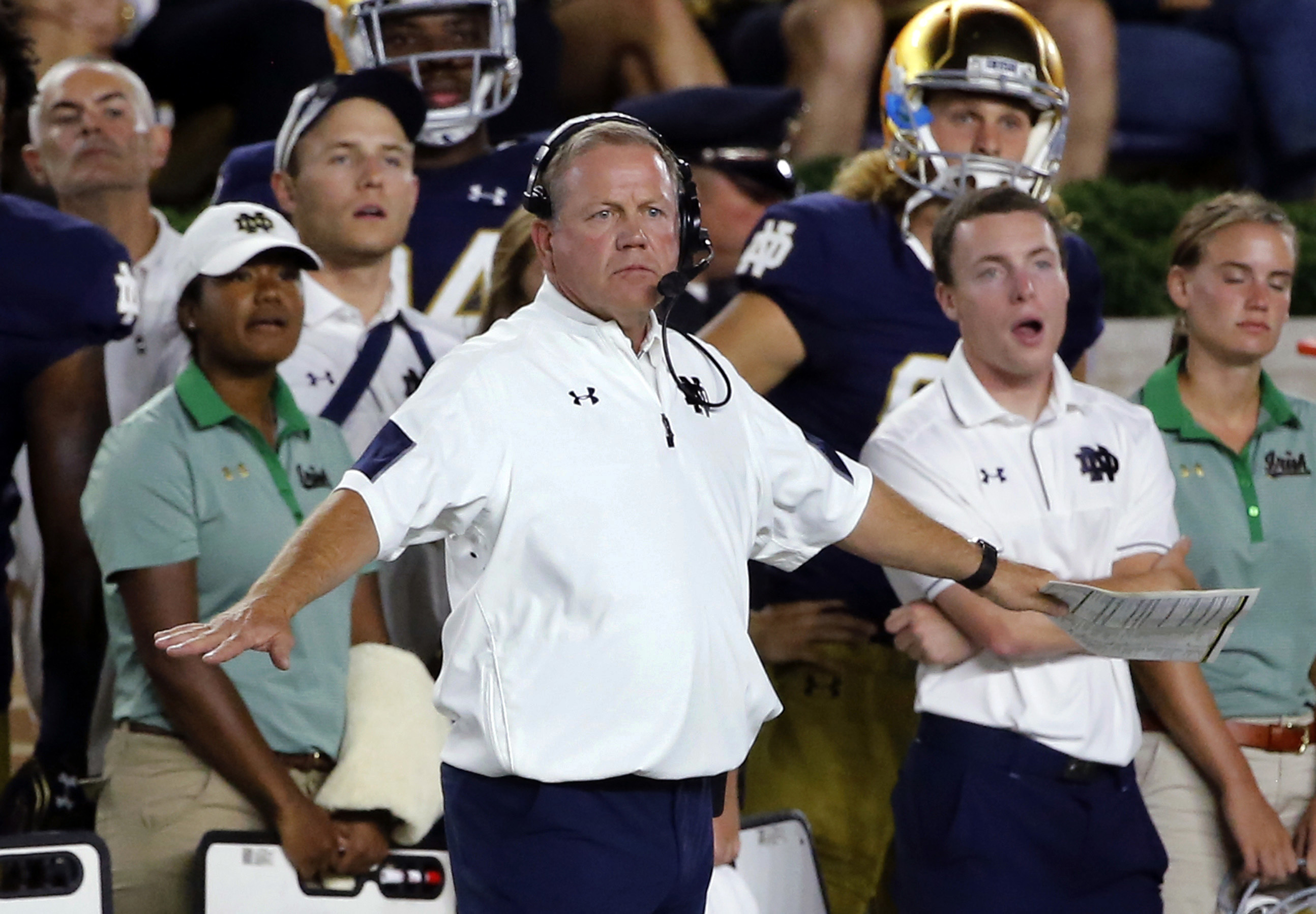 FILE - In this Sept. 17, 2016, file photo, Notre Dame head coach Brian Kelly signals from the sideline during the first half of an NCAA college football game against Michigan State in South Bend, Ind. Notre Dame keeps shooting itself in the foot with spec