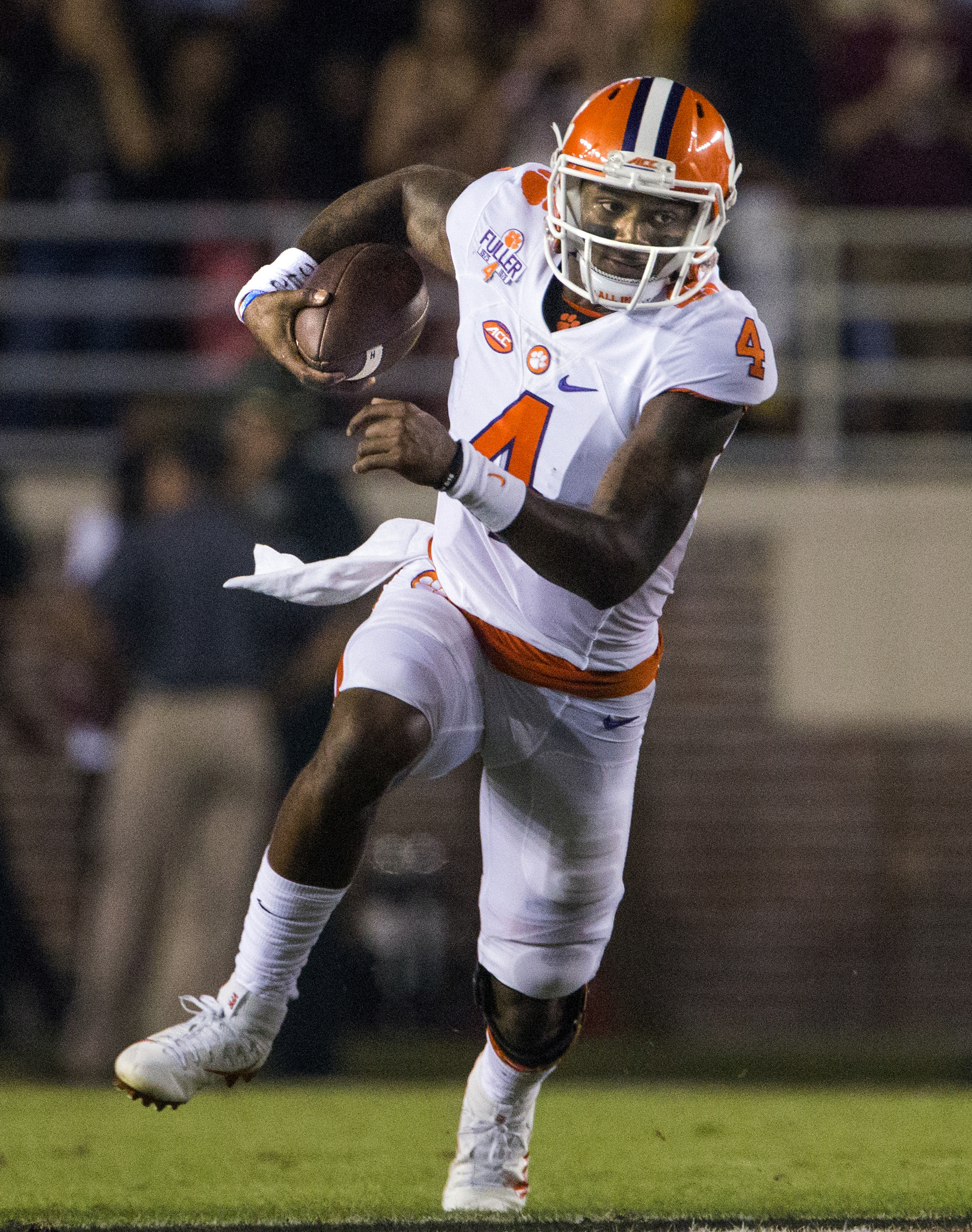 FILE - In this Saturday, Oct. 29, 2016, file photo, Clemson quarterback Deshaun Watson runs during the first half of the team's NCAA college football game against Florida State in Tallahassee, Fla. Watson threw for 378 yards, two touchdowns and two interc