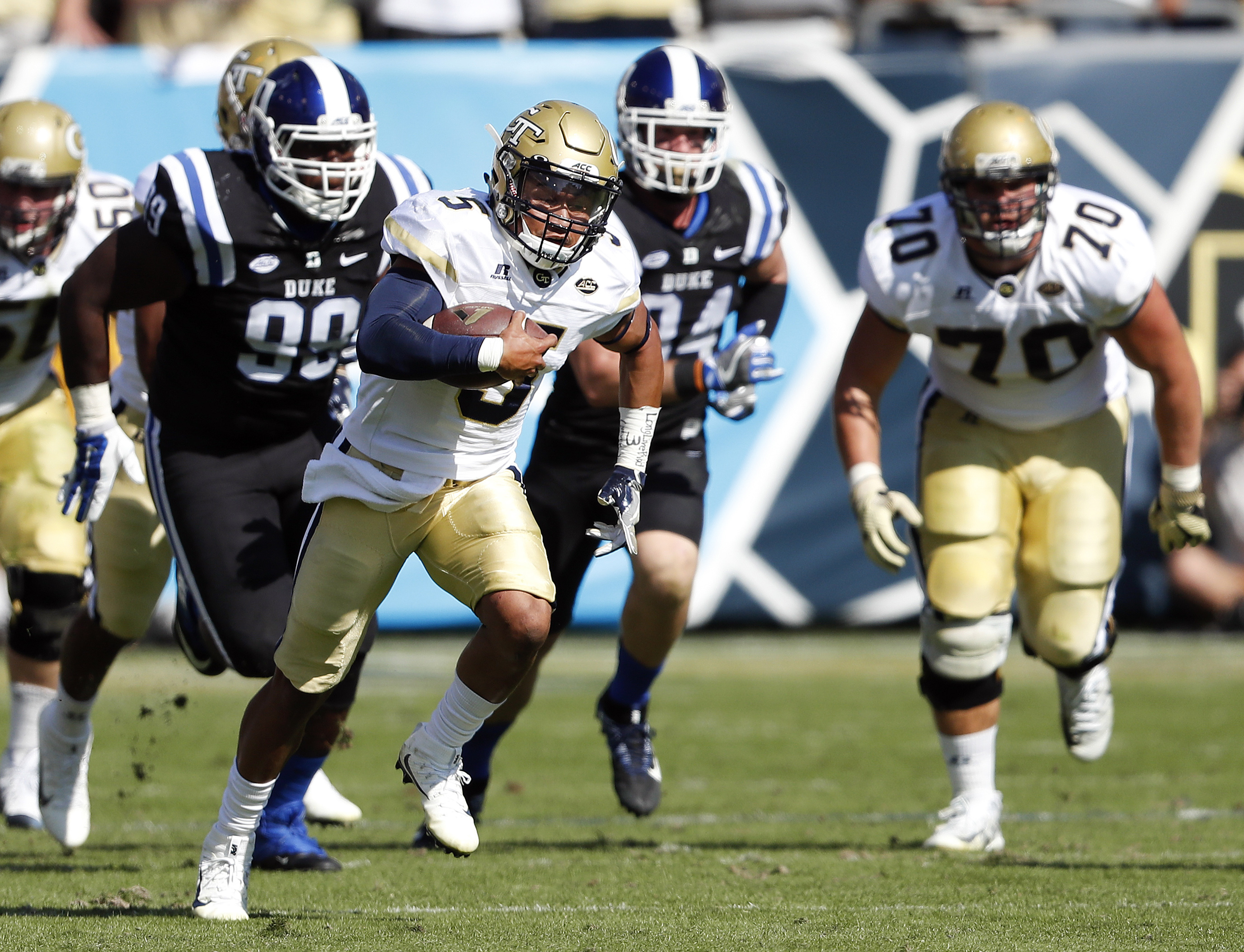 FILE - In this Saturday, Oct. 29, 2016, file photo, Georgia Tech quarterback Justin Thomas breaks away from the Duke defense in the first half of an NCAA college football game in Atlanta.  Thomas has thrilled fans before with his electrifying runs through