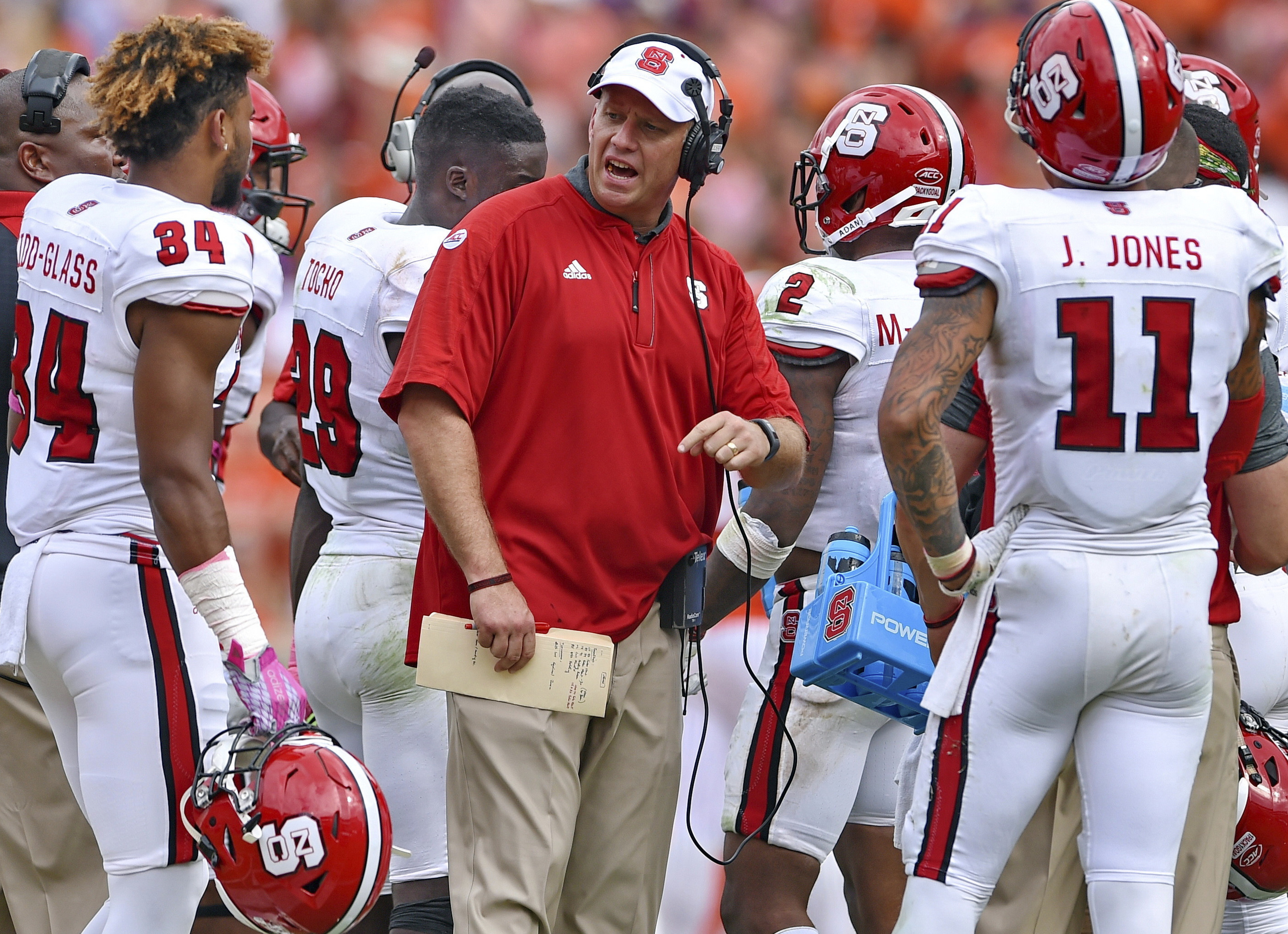 FILE - In this Oct. 15, 2016, file photo, North Carolina State head coach Dave Doeren reacts during the second half of an NCAA college football game against Clemson in Clemson, S.C. The Wolfpack lost eight turnovers during a three-game losing streak enter