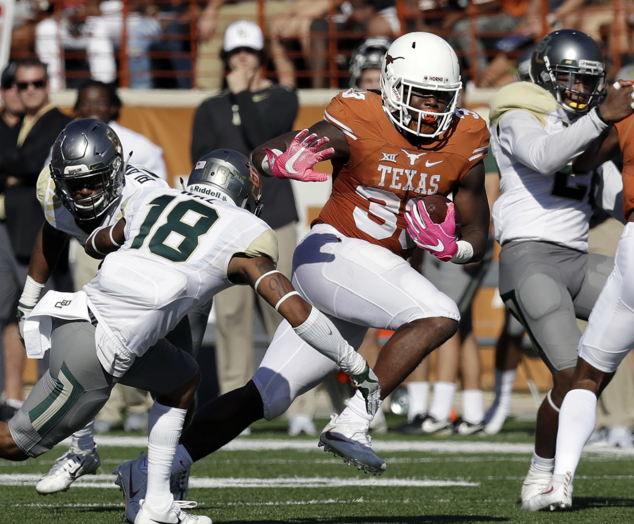 FILE - In this Saturday, Oct. 29, 2016, file photo, Texas running back D'Onta Foreman (33) runs past Baylor safety Chance Waz (18) during an NCAA college football game in Austin, Texas. Foreman leads the Big 12 with 158 yards rushing per game, which is se
