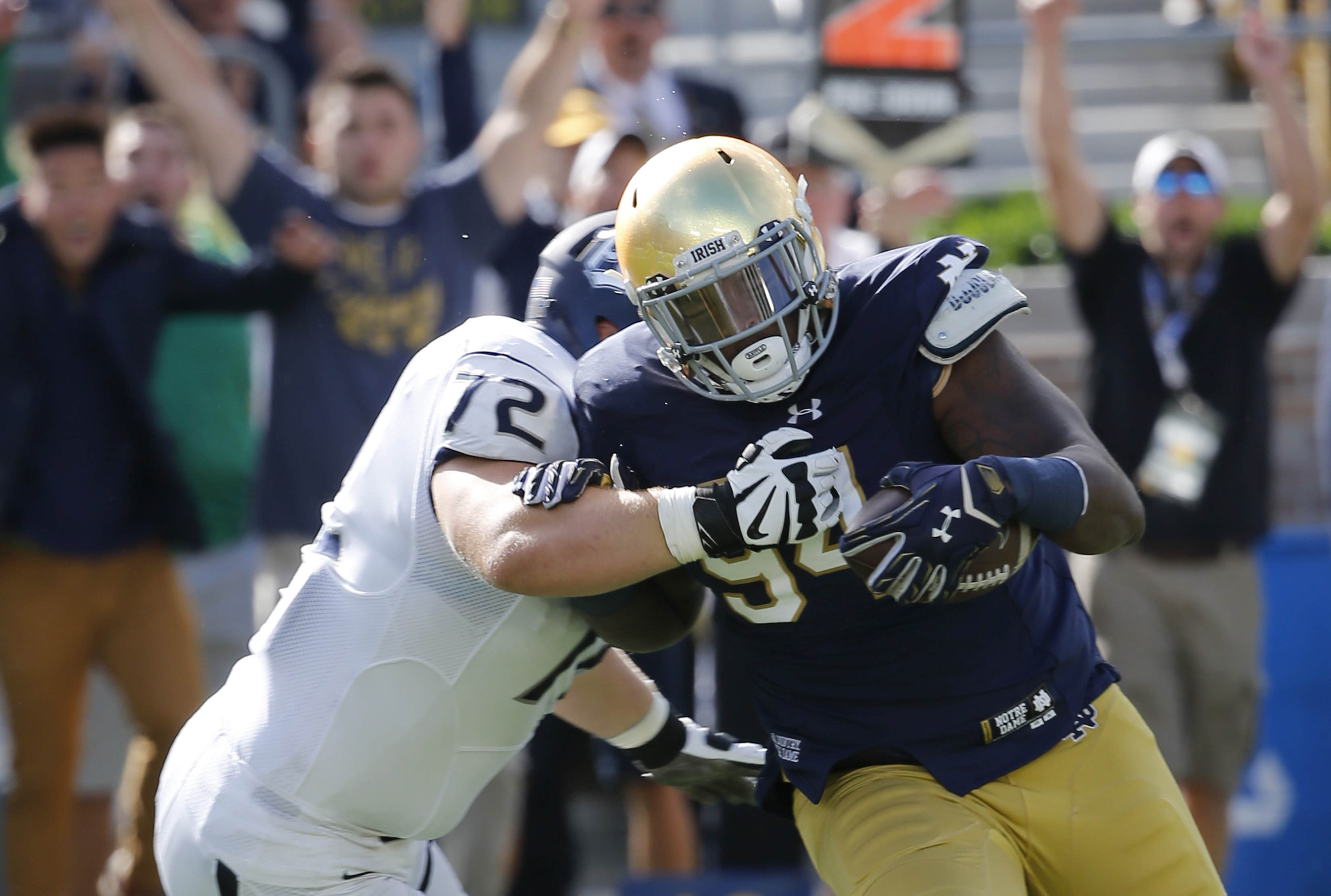 FILE - In this Sept. 10, 2016, file photo, Notre Dame defensive lineman Jarron Jones, right, returns on interception of a pass by Nevada quarterback Tyler Stewart as offensive lineman Jeremy Macauley defends during the first half of an NCAA college footba