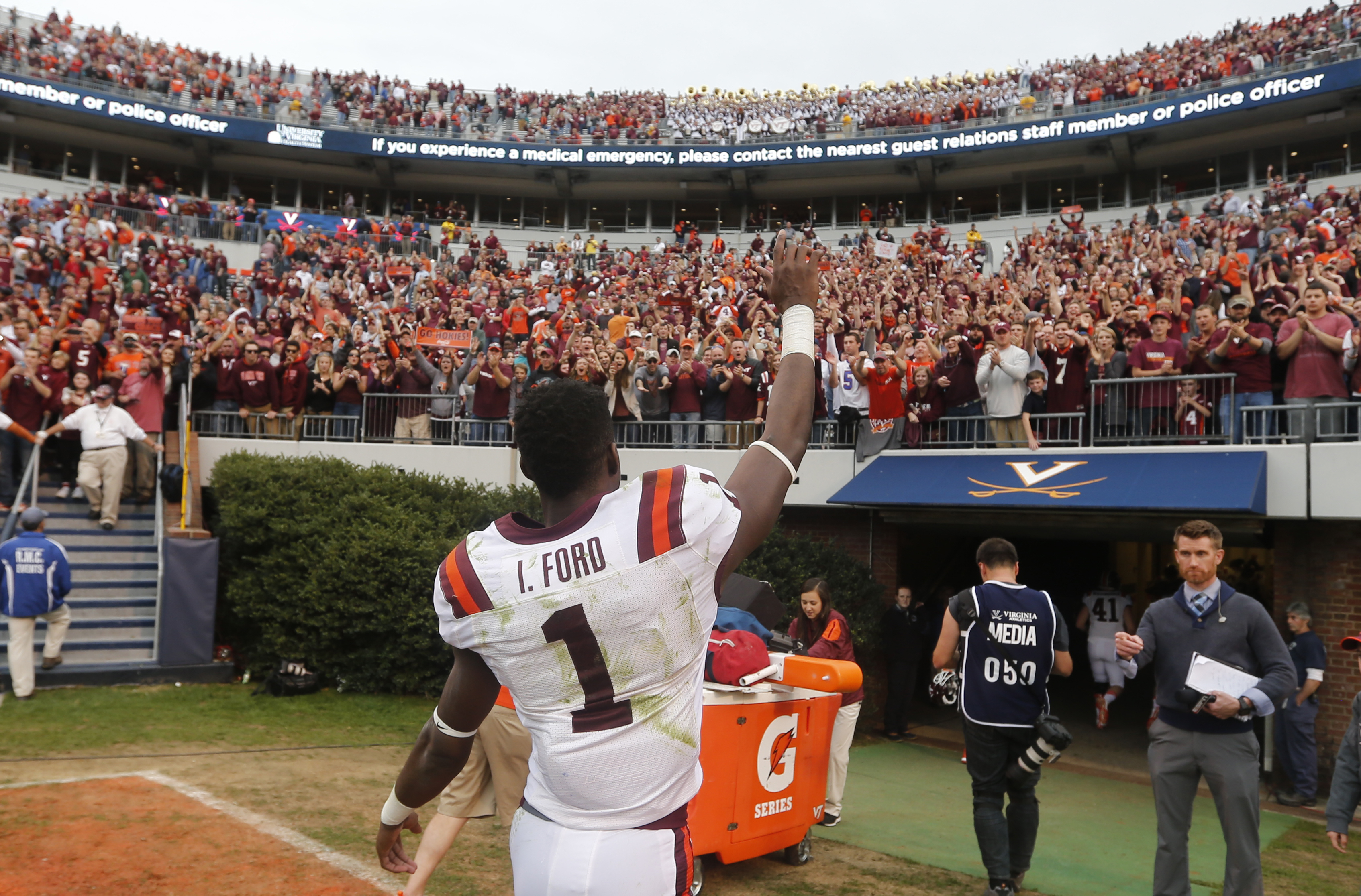 FILE - In this Nov. 28, 2015, file photo, Virginia Tech wide receiver Isaiah Ford (1) waves to the crowd after his team defeated Virginia 23-20 after an NCAA college football game in Charlottesville, Va. One of the things that has most impressed first-yea