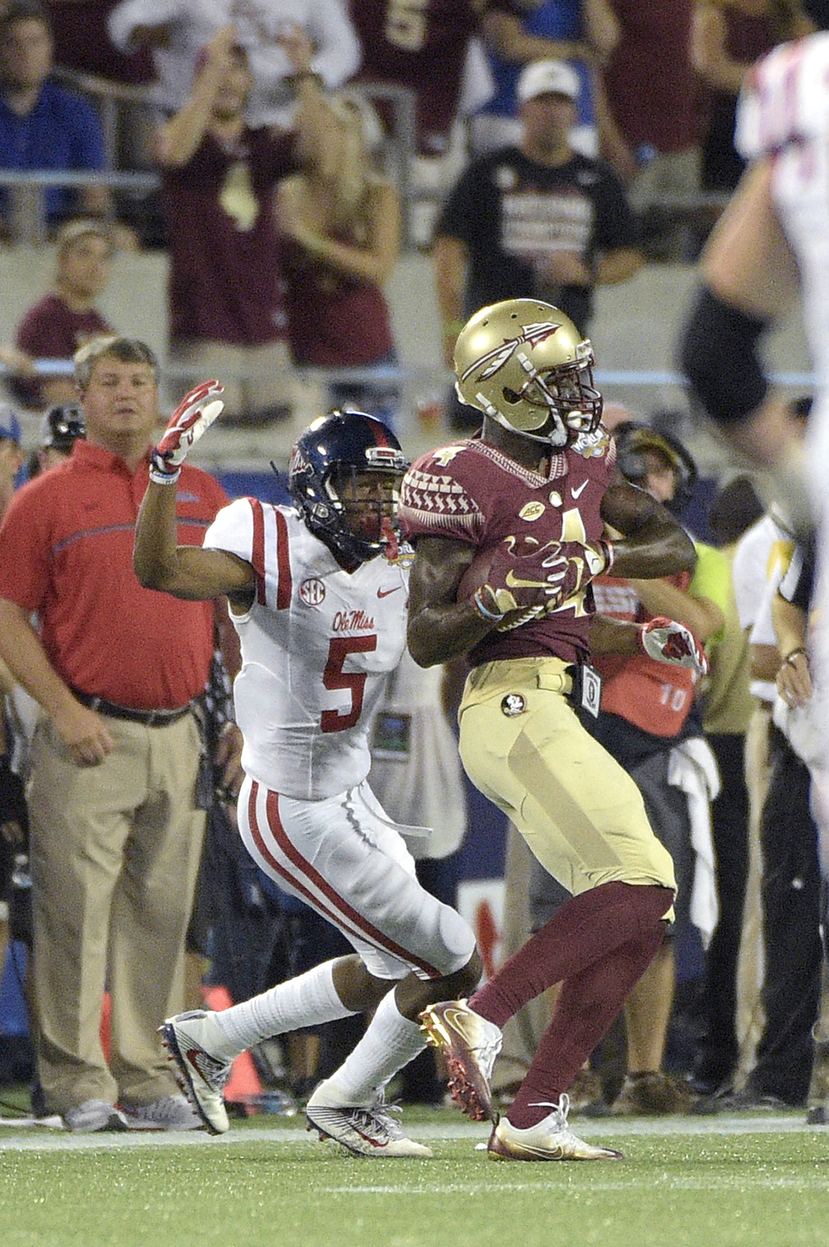 FILE- In this Sept. 6, 2016, file photo, Florida State defensive back Tarvarus McFadden (4) intercepts a pass intended for Mississippi wide receiver DaMarkus Lodge (5) during the second half of an NCAA college football game in Orlando. McFadden, who had a