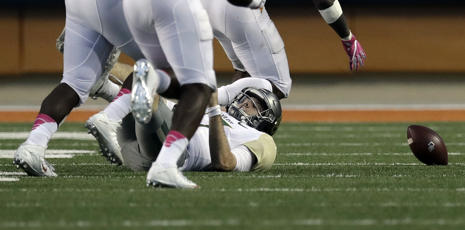 FILE - In this Oct. 29, 2016, file photo, Baylor quarterback Seth Russell (17) falls to the turf after he was hit by Texas linebacker Malik Jefferson (46) as he tired to pass during the final seconds of the second half on a NCAA college football game, in