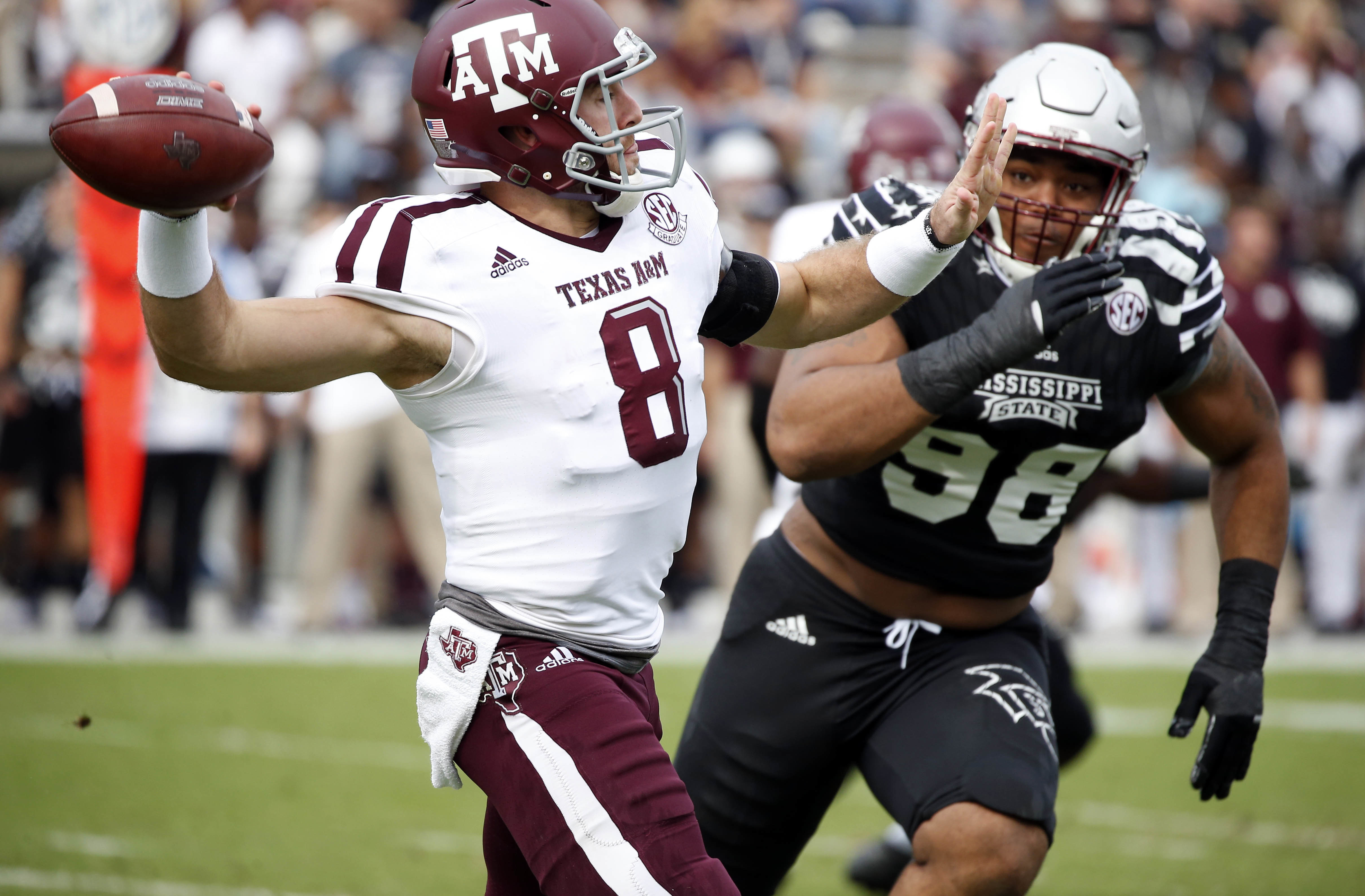 Texas A&M quarterback Trevor Knight (8) is pressured by Mississippi State defensive lineman Jeffery Simmons (98) as he passes in the first half of an NCAA college football game in Starkville, Miss., Saturday, Nov. 5, 2016. (AP Photo/Rogelio V. Solis)
