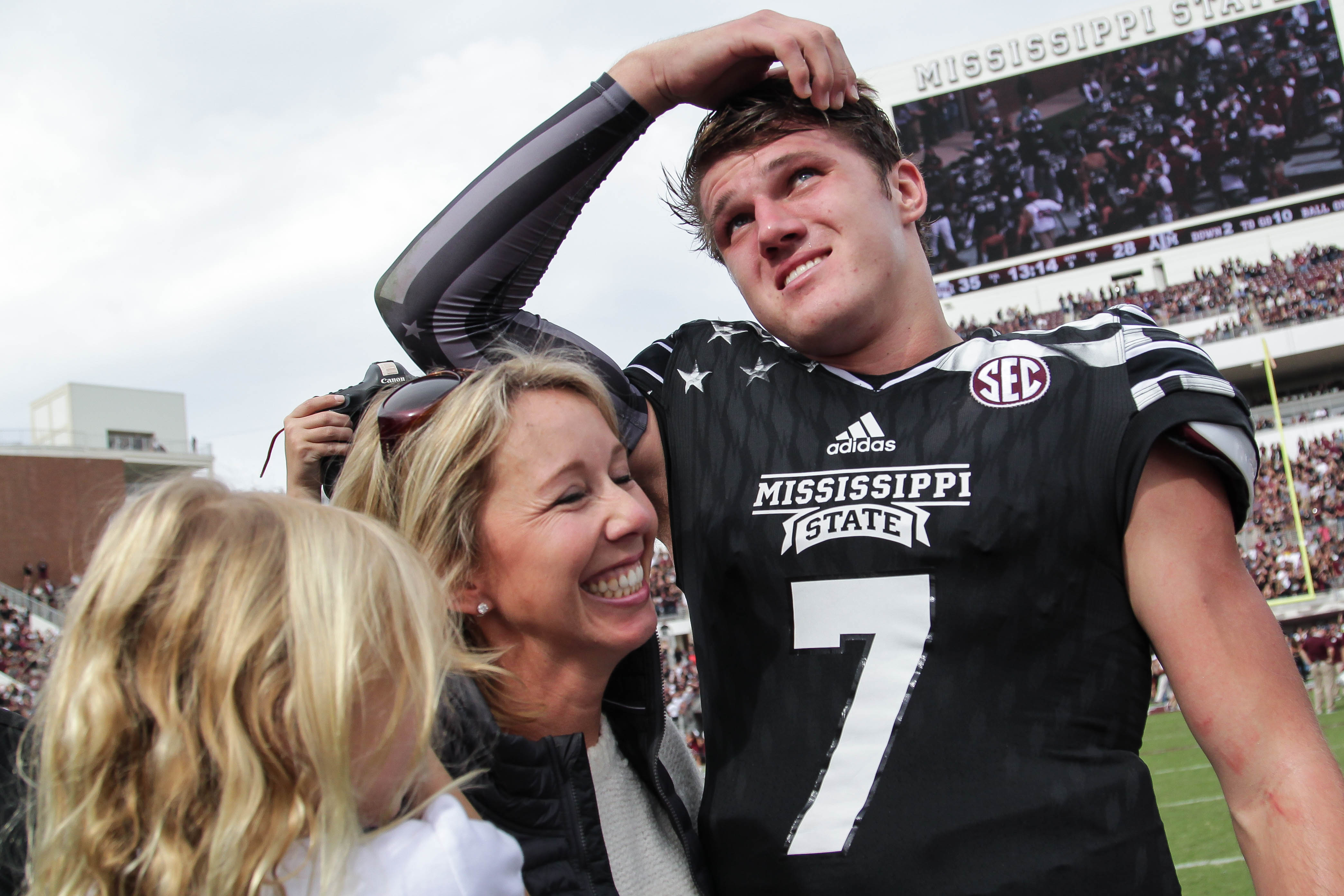 Megan Mullen, wife of Mississippi State coach Dan Mullen, celebrates with quarterback Nick Fitzgerald after defeating Texas A&M 35-28 in an NCAA college football game at Davis Wade Stadium at Scott Field in Starkville, Miss., Saturday, Nov. 5, 2016.  (Jam