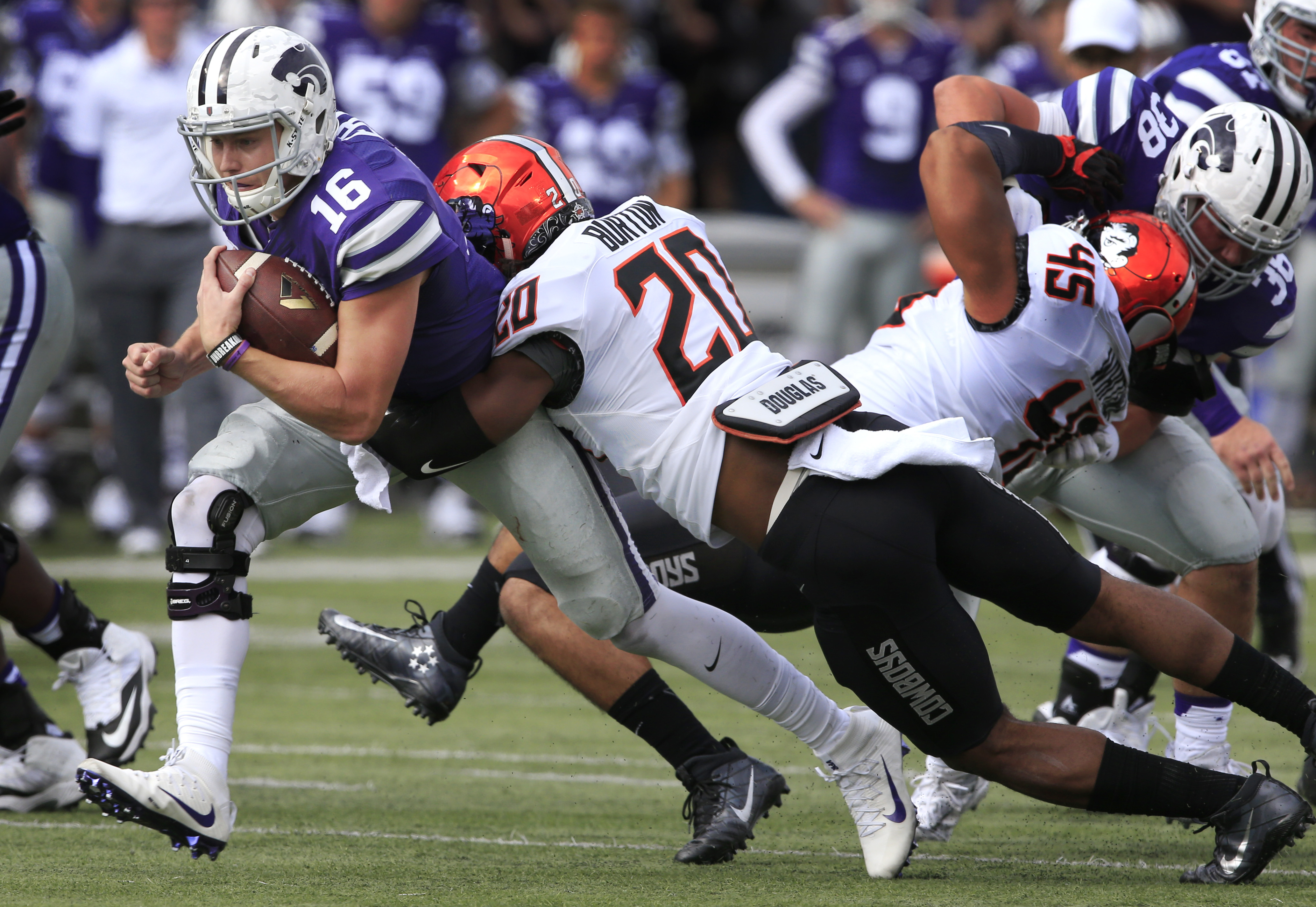 Kansas State quarterback Jesse Ertz (16) is tackled by Oklahoma State linebacker Jordan Burton (20) during the first half of an NCAA college football game in Manhattan, Kan., Saturday, Nov. 5, 2016. (AP Photo/Orlin Wagner)
