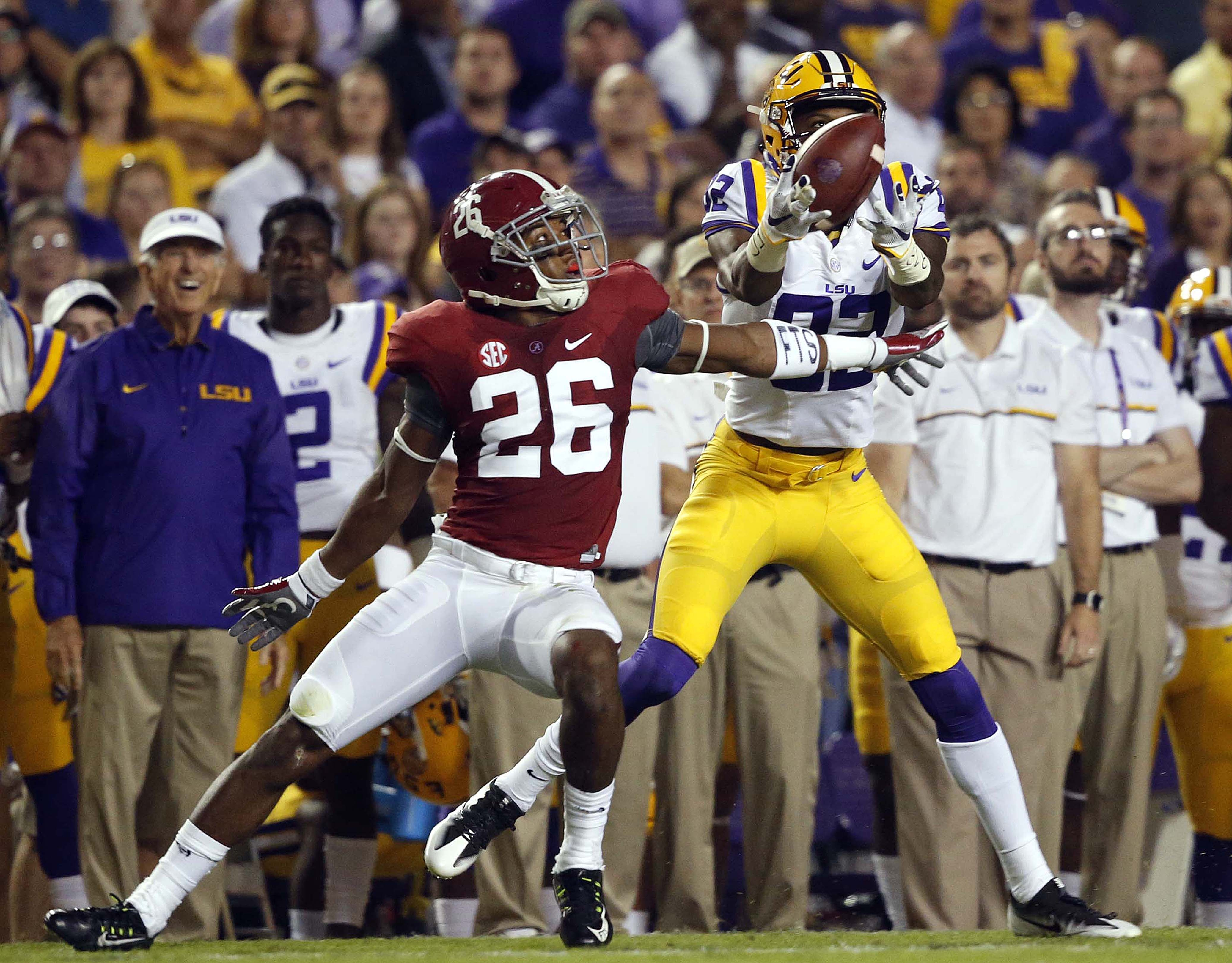 LSU wide receiver D.J. Chark (82) pulls in a long pass reception in front of Alabama defensive back Marlon Humphrey (26) in the first half of an NCAA college football game in Baton Rouge, La., Saturday, Nov. 5, 2016. (AP Photo/Gerald Herbert)