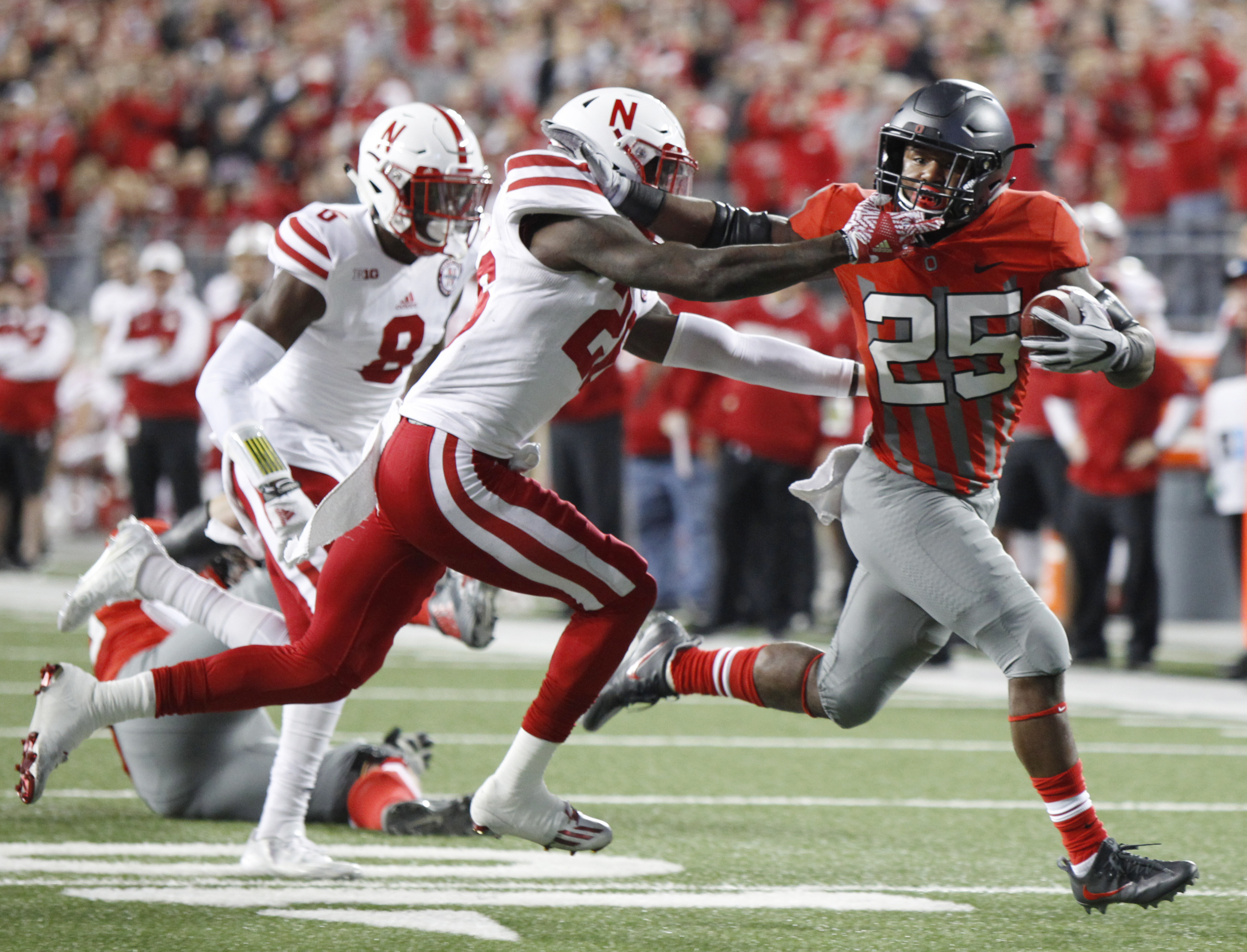 Ohio State running back Mike Weber, right, stiff-arms Nebraska linebacker Thomas Connely on his way to scoring a touchdown during the first half of an NCAA college football game Saturday, Nov. 5, 2016, in Columbus, Ohio. (AP Photo/Paul Vernon)