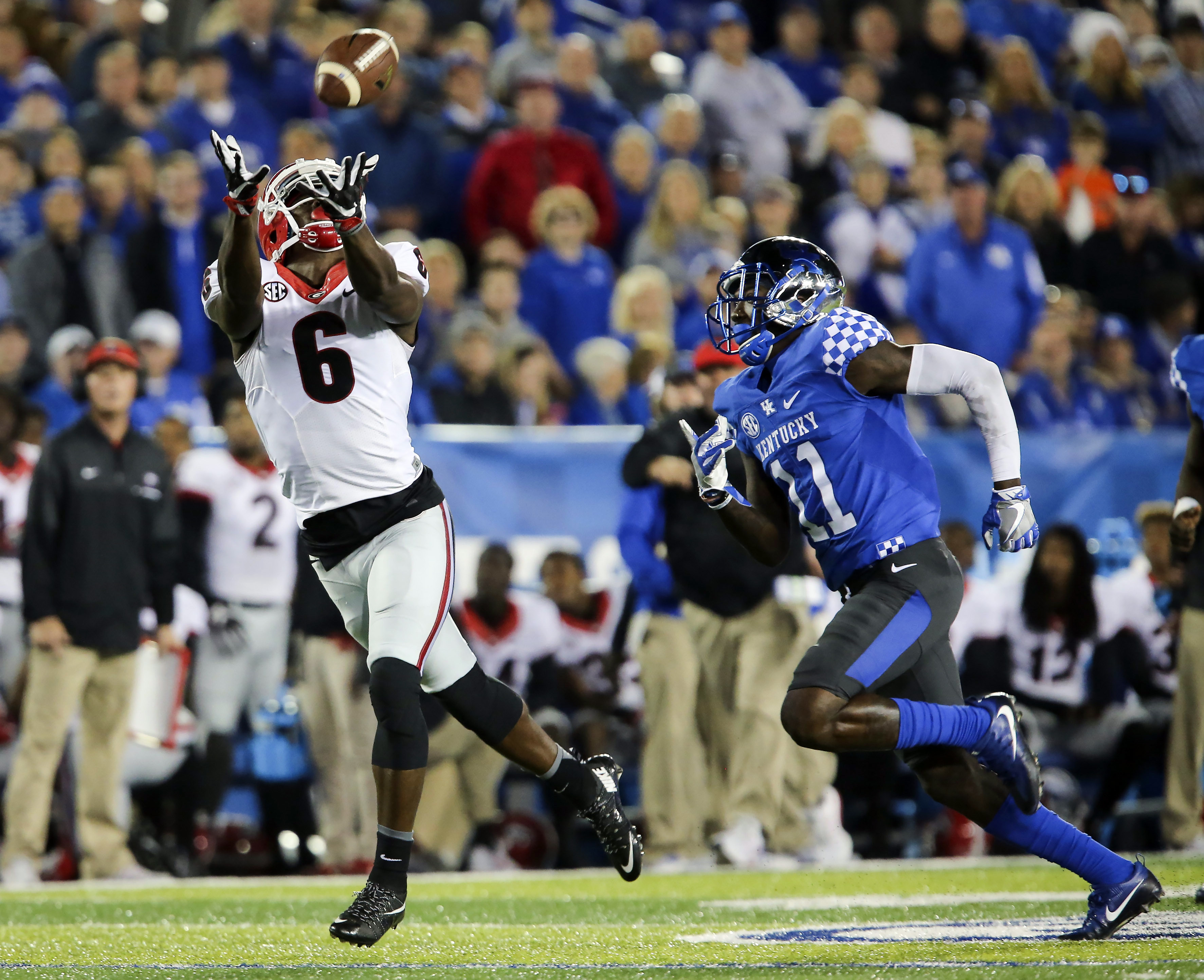Georgia wide receiver Javon Wims (6) catches a pass in front of Kentucky cornerback J.D. Harmon for a first down in the first half of an NCAA college football game Saturday, Nov. 5, 2016, in Lexington, Ky. (AP Photo/David Stephenson)