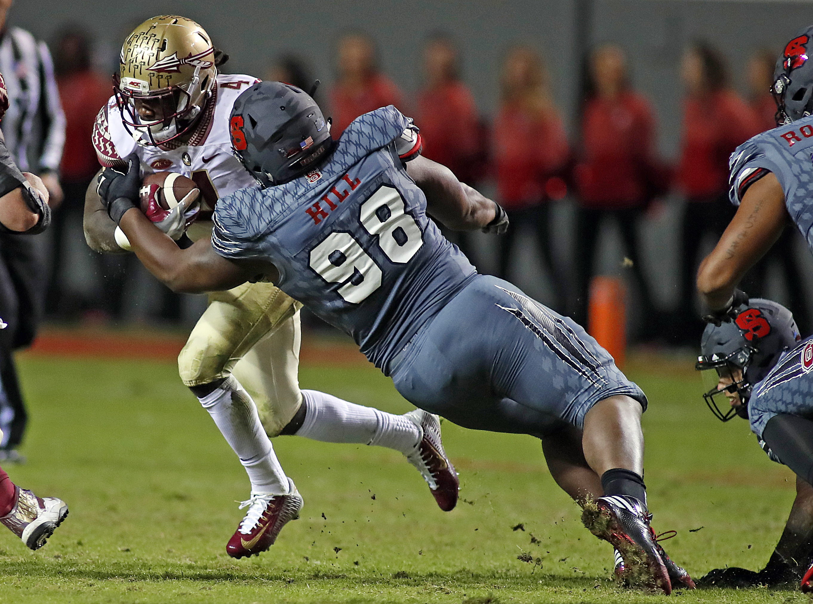 Florida State's Dalvin Cook (4) breaks away from North Carolina State's B.J. Hill (98) during the second half of an NCAA college football game in Raleigh, N.C., Saturday, Nov. 5, 2016. Florida State won 24-20. (AP Photo/Karl B DeBlaker)