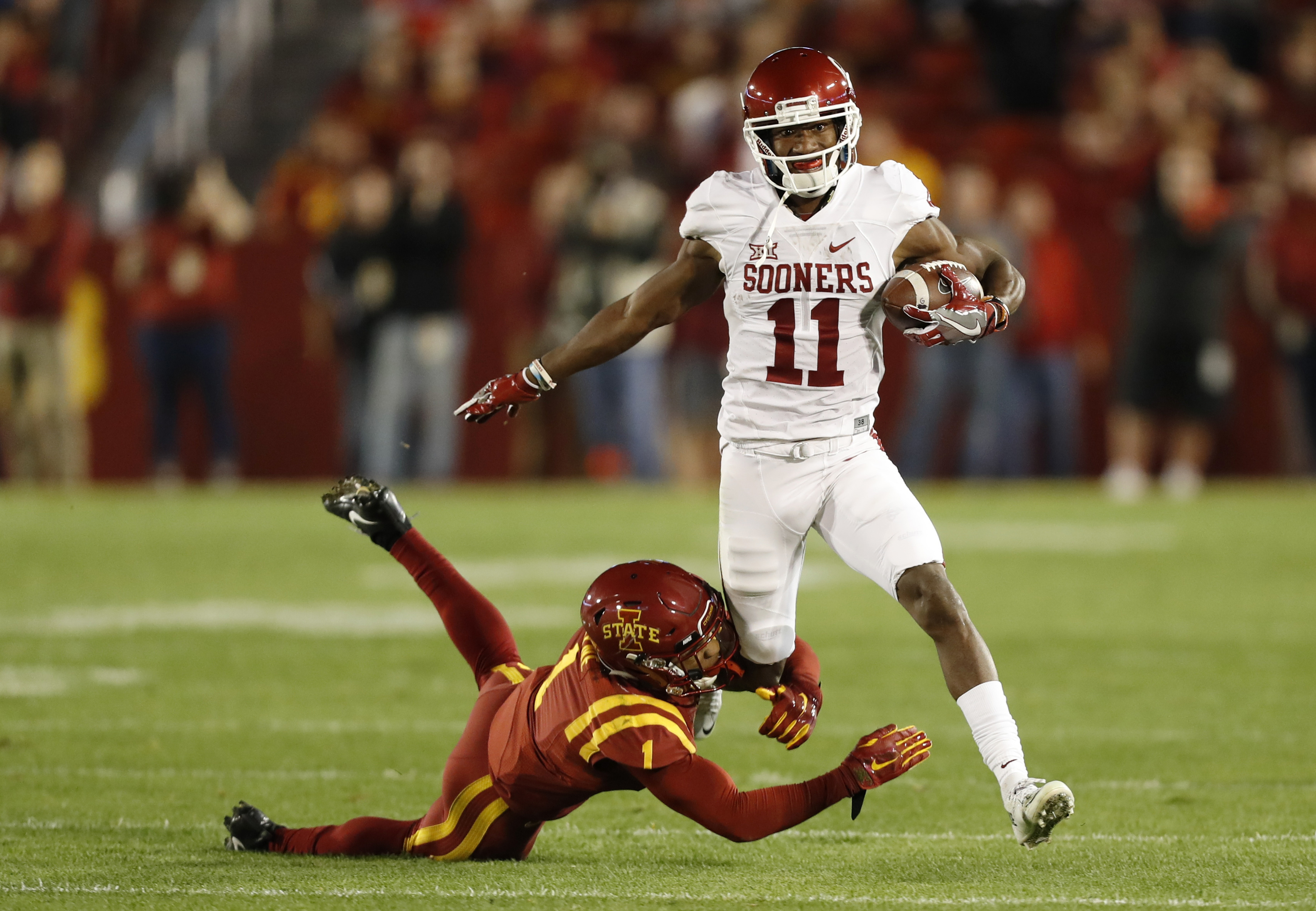 FILE - In this Nov. 3, 2016, file photo, Oklahoma wide receiver Dede Westbrook (11) runs from Iowa State defensive back D'Andre Payne during the first half of an NCAA college football game, in Ames, Iowa. Westbrook is having the best stretch of games ever