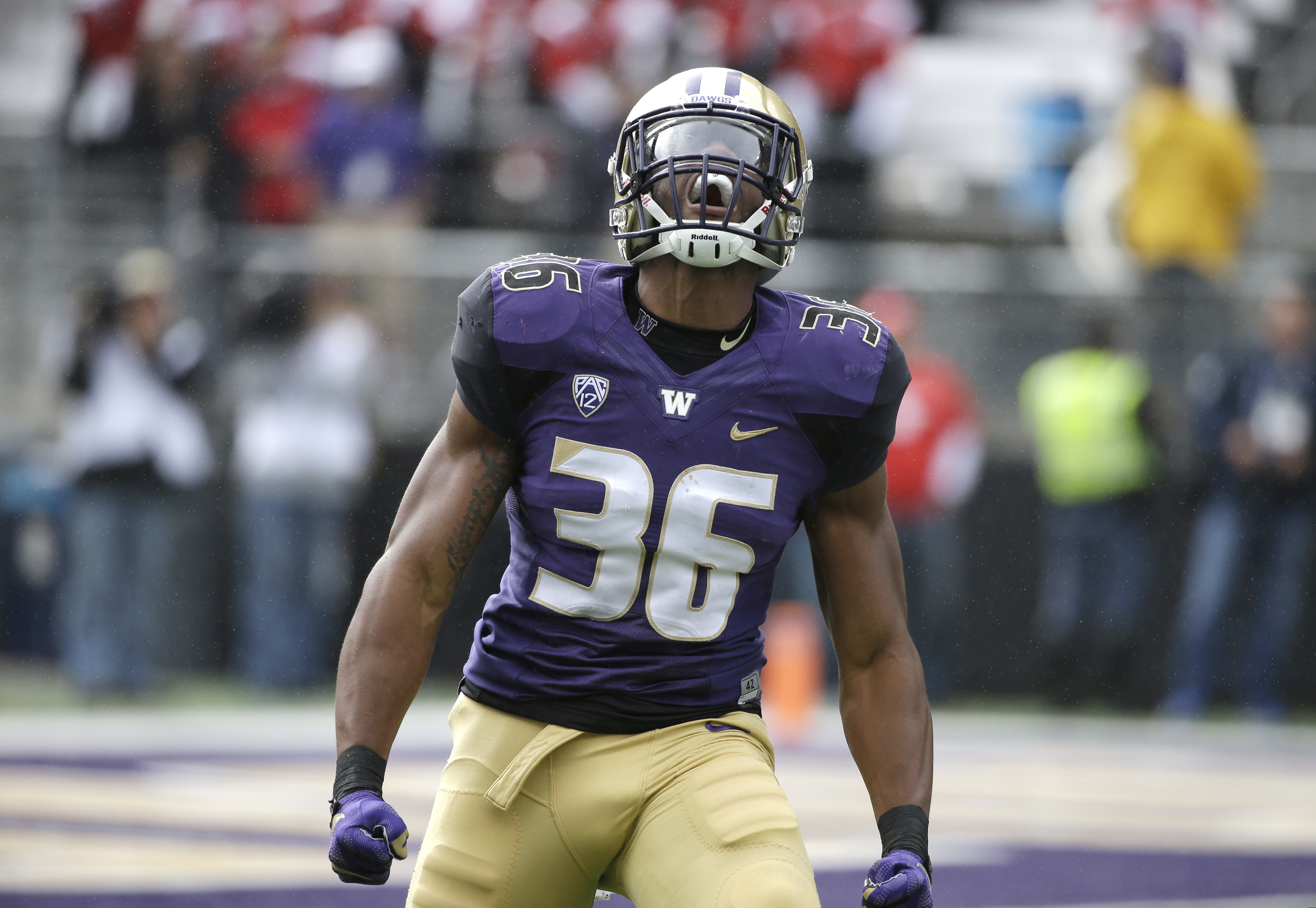 FILE - In this Sept. 3, 2016, file photo, Washington's Azeem Victor reacts to a play against Rutgers in the first half of an NCAA college football game, in Seattle. In the midst of being the starting middle linebacker for the No. 4 team in the country, Az