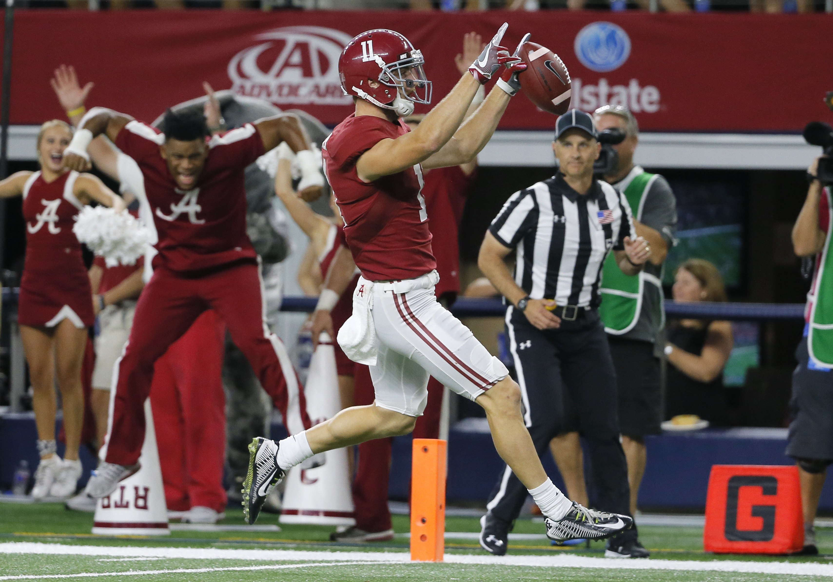 FILe - In this Sept. 3, 2016, file photo, Alabama wide receiver Gehrig Dieter celebrates as he crosses into the end zone after catching a pass during the second half of an NCAA college football game against Southern California, in Arlington, Texas. Teams