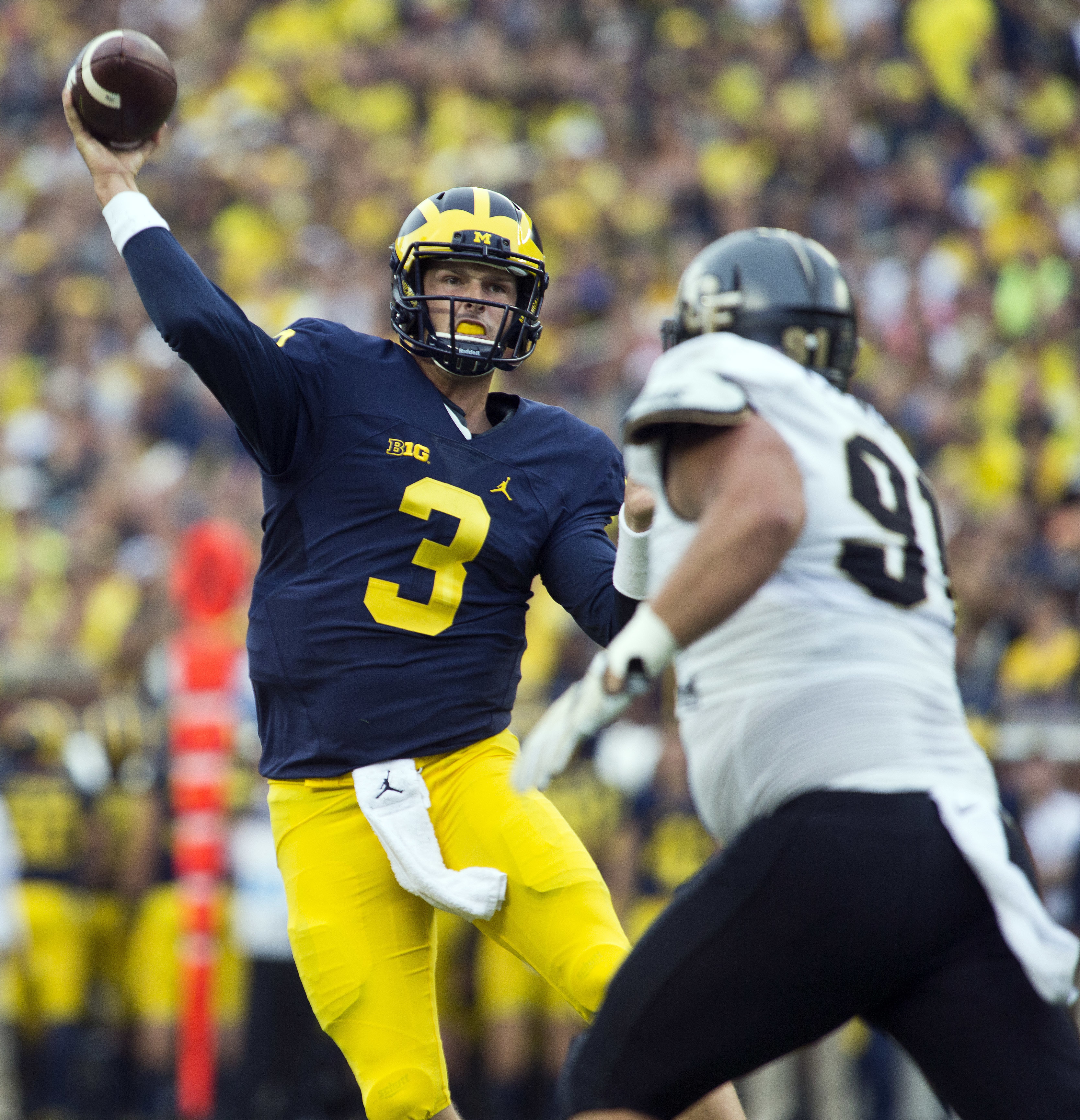 FILE - In this Sept. 10, 2016, file photo, Michigan quarterback Wilton Speight (3) throws a pass in the second quarter of an NCAA college football game against Central Florida at Michigan Stadium in Ann Arbor, Mich. Michigan takes on Iowa on Saturday in I