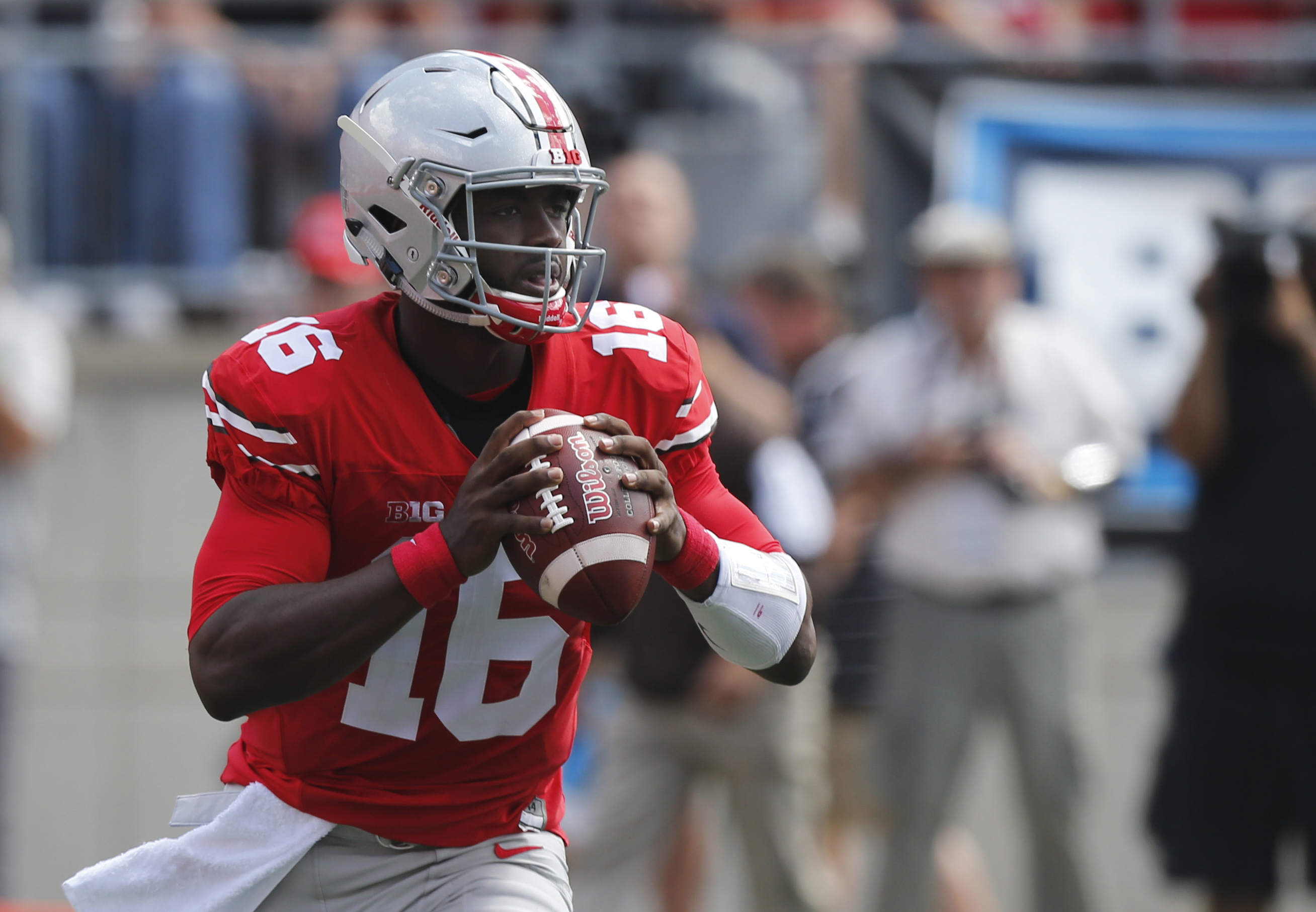 FILE - In this Sept. 3, 2016, file photo, Ohio State quarterback J.T. Barrett plays against Bowling Green during an NCAA college football game, in Columbus, Ohio. Maryland faces Ohio State on Saturday. The Terrapins have lost four of five, including a 59-