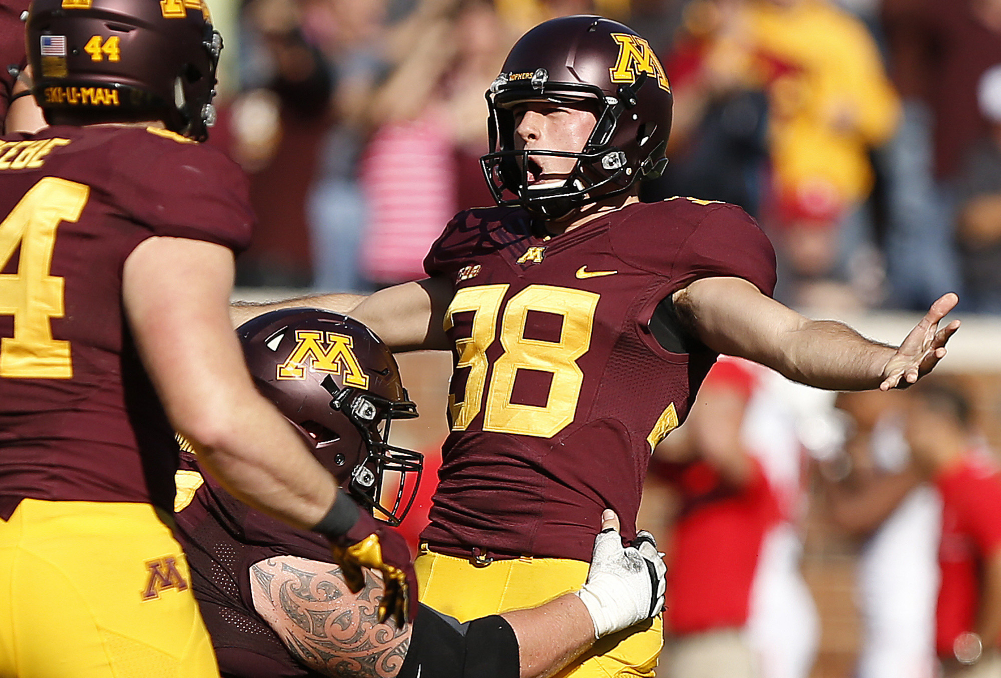 FILE - In this Oct. 22, 2016, file photo, Minnesota kicker Emmit Carpenter, right, celebrates after kicking the game winning field goal against Rutgers in an NCAA college football game in Minneapolis. Carpenter has made quite the debut this season, pickin