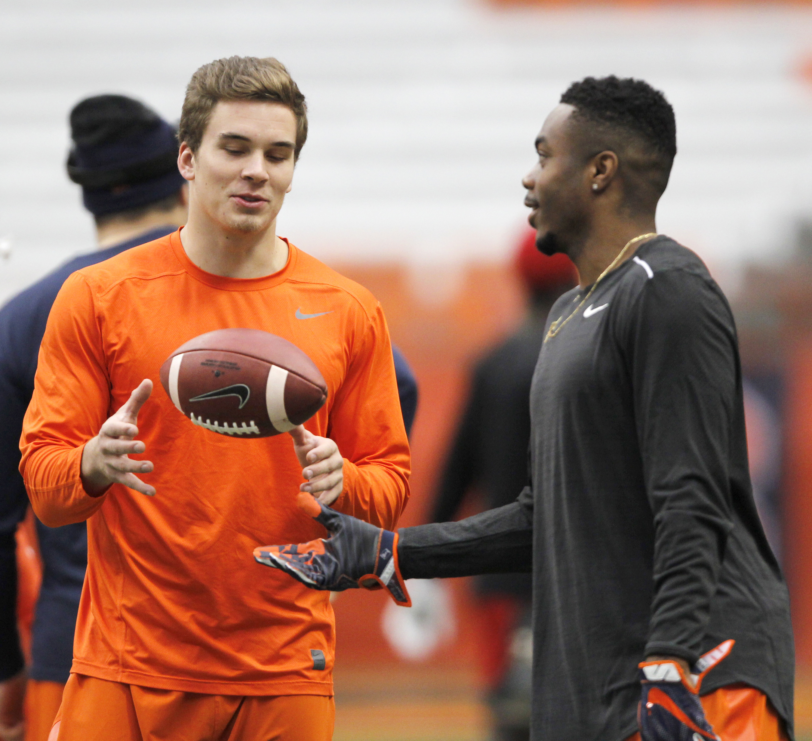 Syracuse's Eric Dungey, left, and Amba Etta-Tawo, right, confer during warm-ups before an NCAA college football game against North Carolina State in Syracuse, N.Y., Saturday, Nov. 12, 2016. (AP Photo/Nick Lisi)
