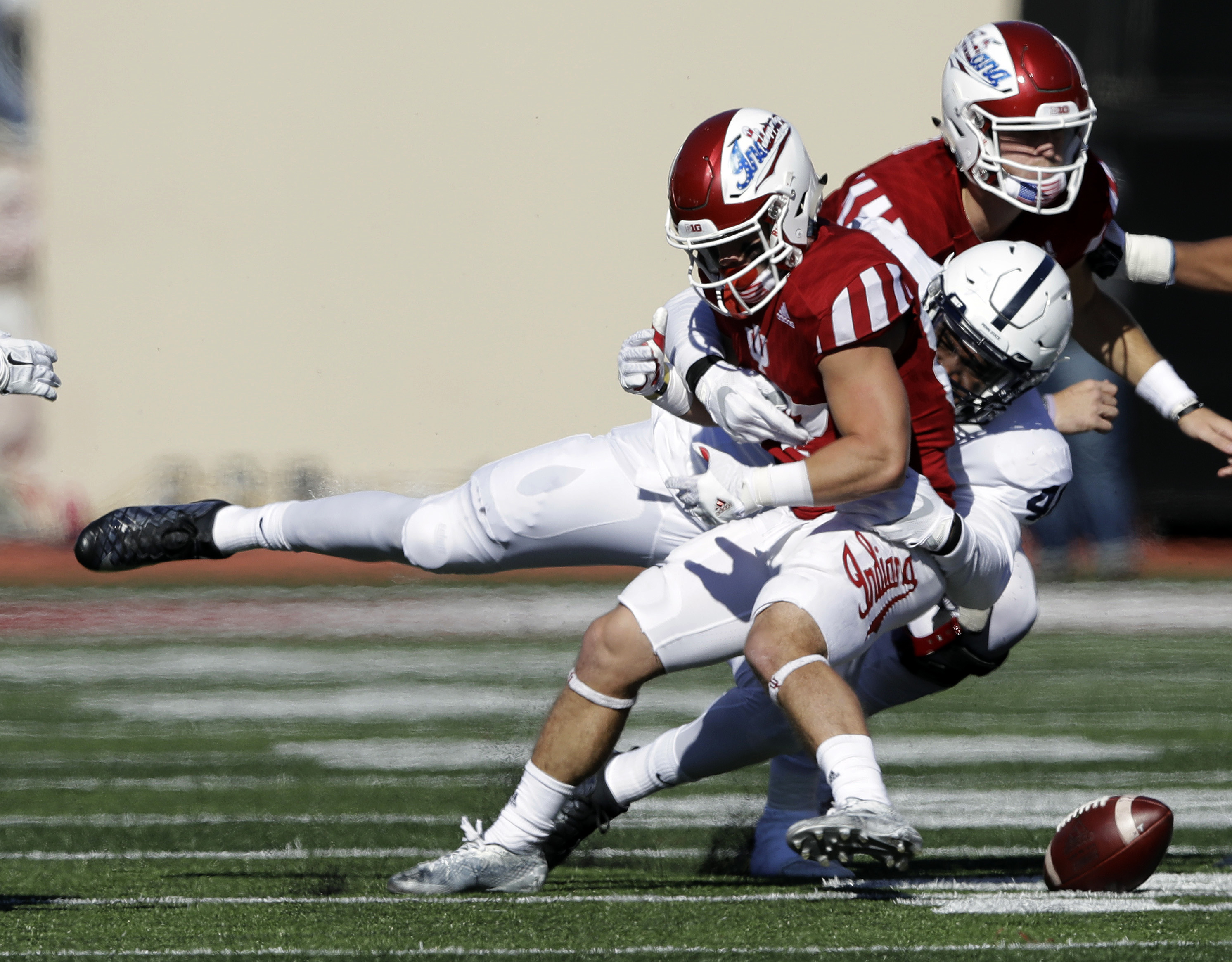 Indiana's Mitchell Paige fumbles after being hit by Penn State's Shareef Miller during the first half of an NCAA college football game Saturday, Nov. 12, 2016, in Bloomington, Ind. (AP Photo/Darron Cummings)