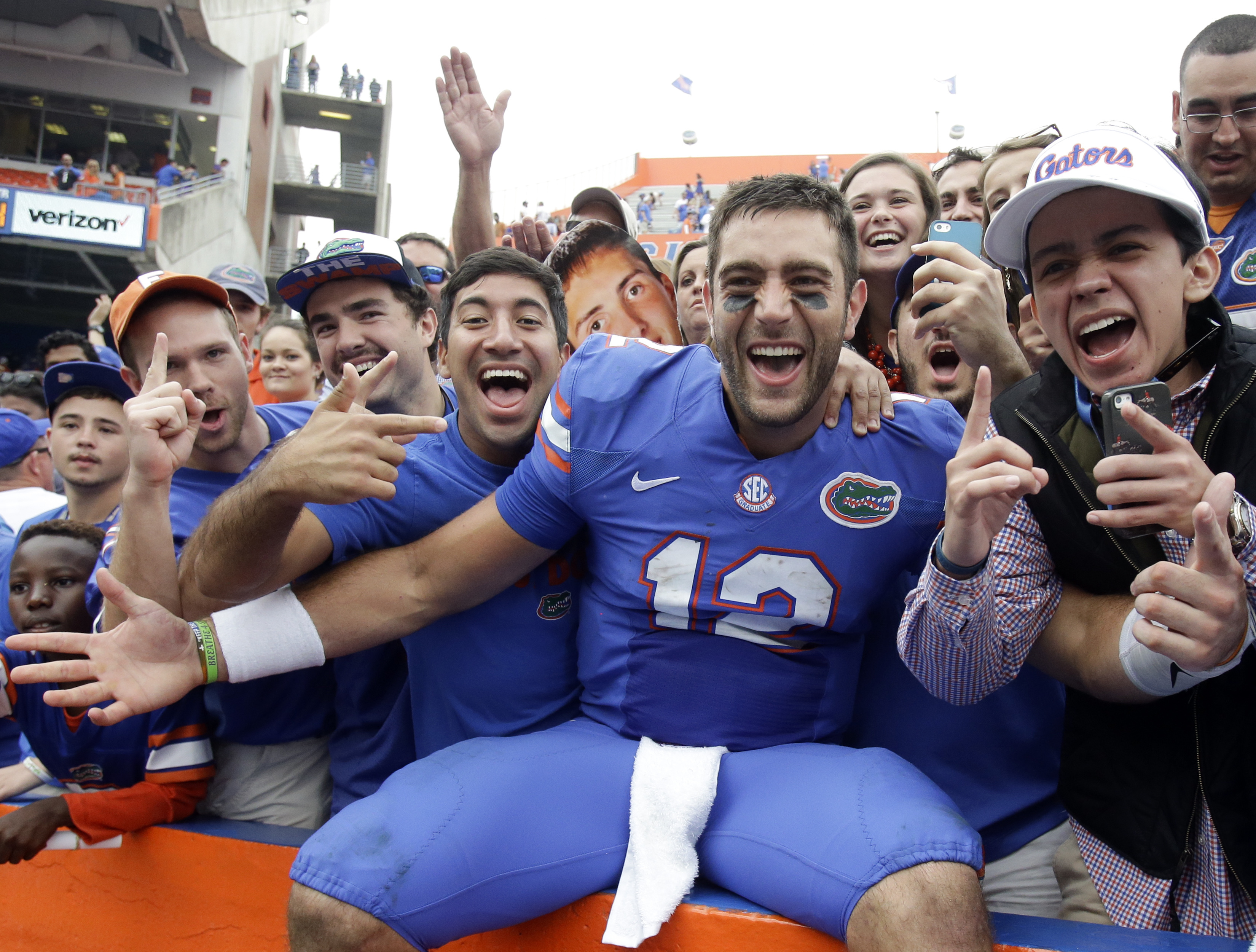 Florida quarterback Austin Appleby (12) celebrates with fans after defeating South Carolina 20-7 in an NCAA college football game, Saturday, Nov. 12, 2016, in Gainesville, Fla. (AP Photo/John Raoux)