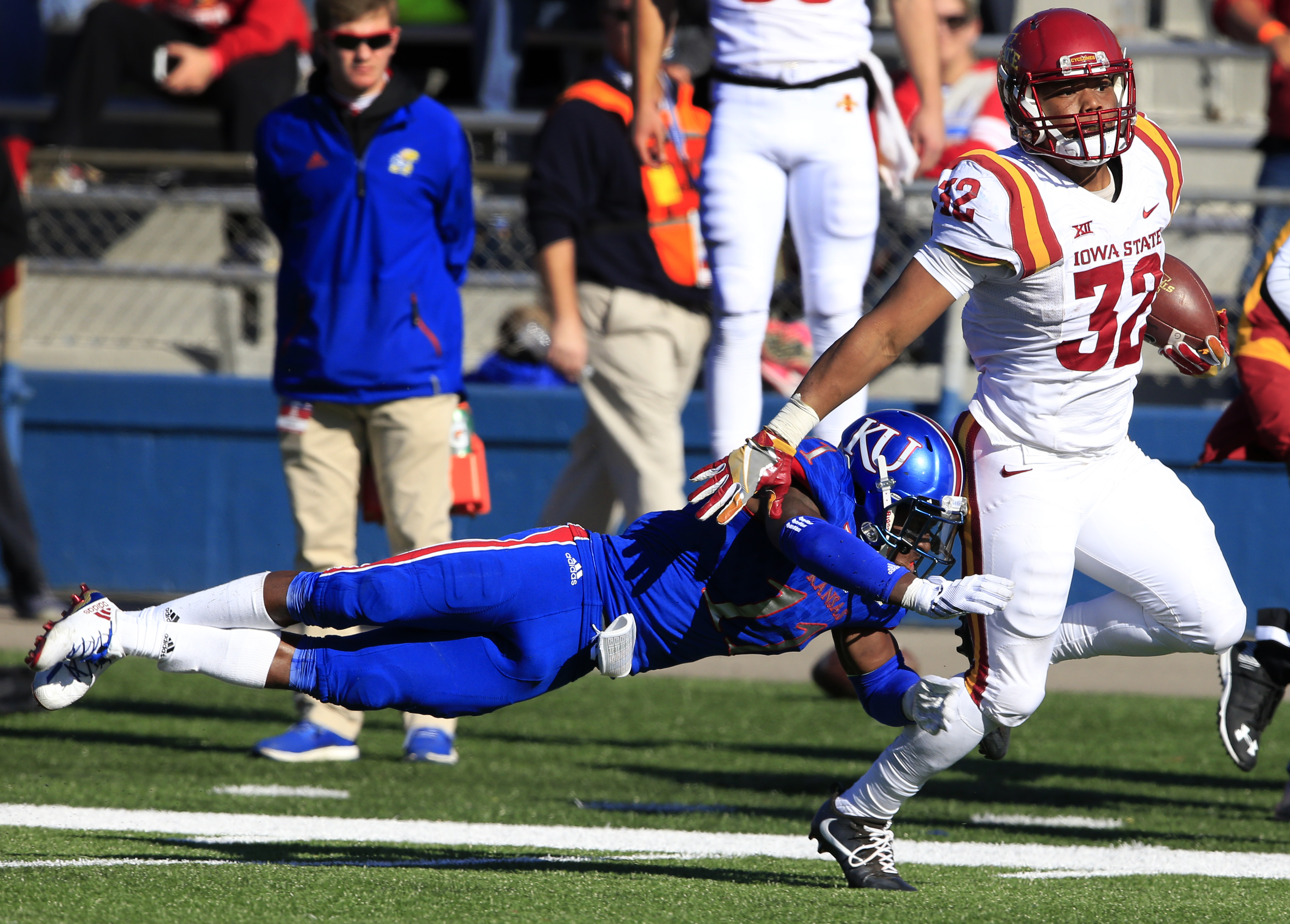 Iowa State running back David Montgomery (32) is tackled after a 46-yard gain by Kansas linebacker Mike Lee (11) during the second half of an NCAA college football game in Lawrence, Kan., Saturday, Nov. 12, 2016. Iowa State defeated Kansas 31-24. (AP Phot