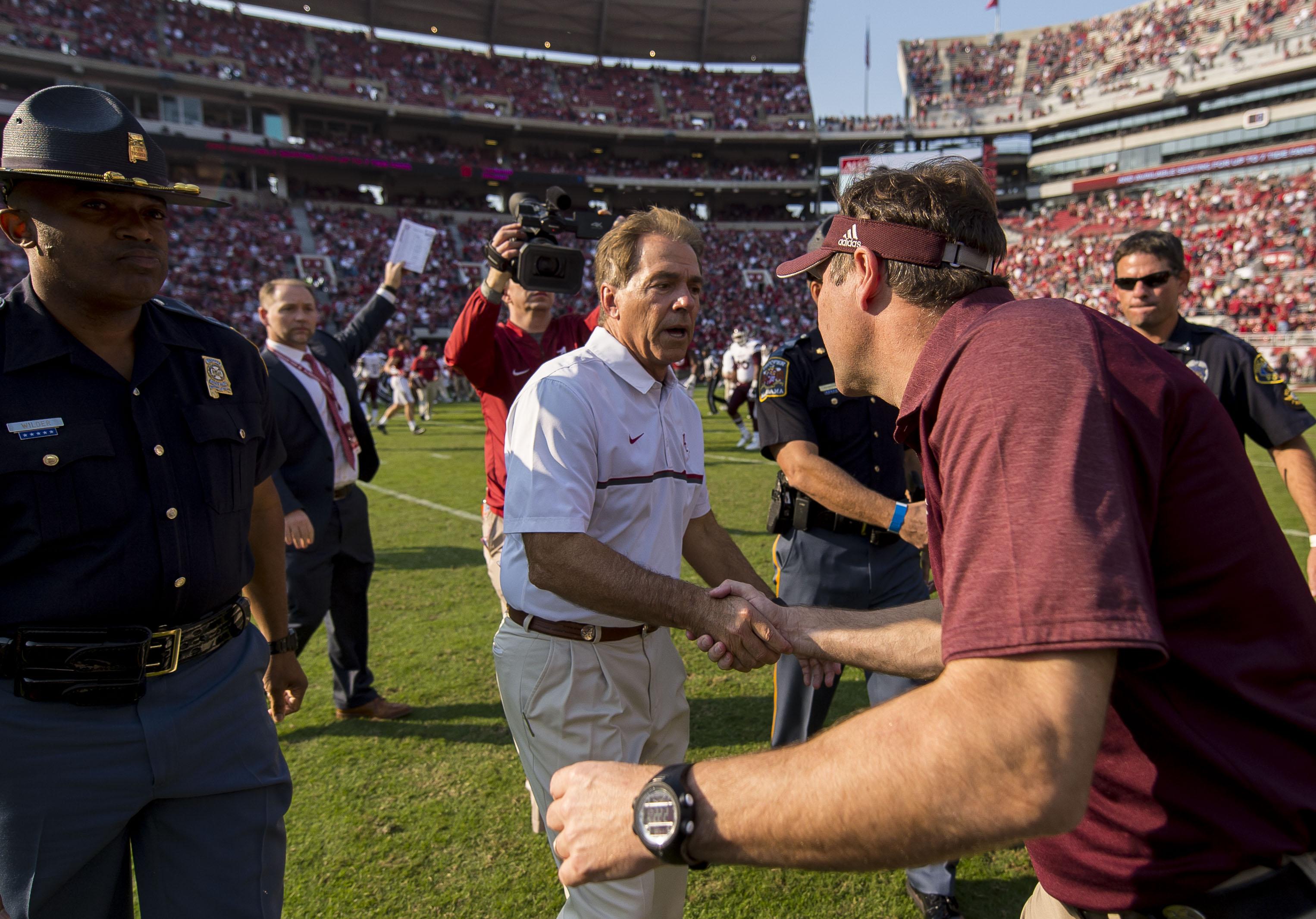 Alabama head coach Nick Saban greets Mississippi State head coach Dan Mullen after their NCAA college football game, Saturday, Nov. 12, 2016, at Bryant-Denny Stadium in Tuscaloosa, Ala. (Vasha Hunt/AL.com via AP) (AP Photo/Alabama Media Group, Vasha Hunt)