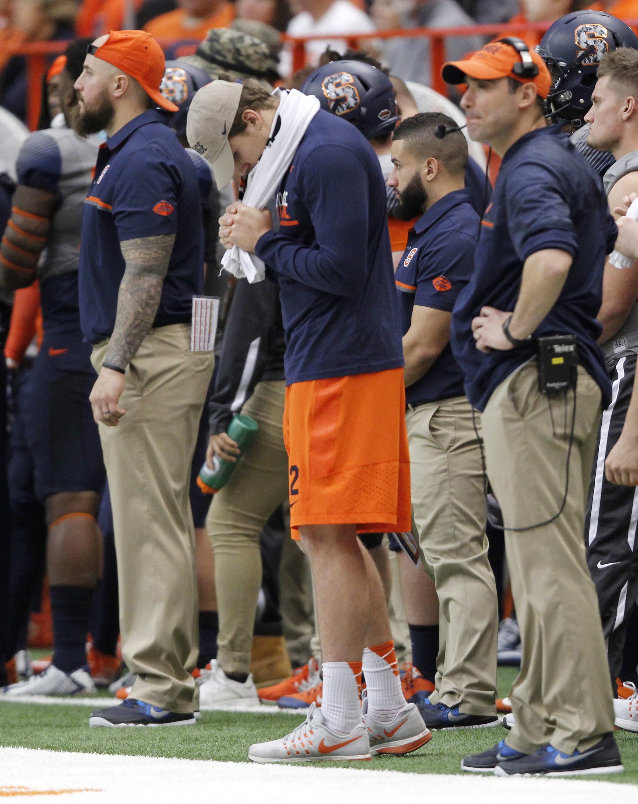 Syracuse's starting quarterback Eric Dungey, center, stands the Syracuse sidelines in the final seconds of an NCAA college football game against North Carolina State in Syracuse, N.Y., Saturday, Nov. 12, 2016. Dungey could not play because of an injury. N